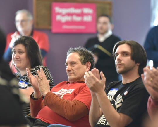 U.S. Congressman Andy Levin, center, claps with DPSCD middle school teacher Marnina Falk, left, of Ferndale, and South Macomb County middle school teacher Robert Jay attend the one-year anniversary of the March for Our Lives at First Unitarian-Universalist Church 'Cass Corridor Commons, Sunday, March 24, 2019. Last year, ten thousand youth activists and adults marched along the Detroit River and Woodward Avenue to demand solutions to gun violence and mass shootings as a sister march to the one held in DC by students from Stoneman-Douglass High School.