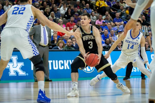 Wofford guard Fletcher Magee looks to pass the ball in the Kentucky game.
