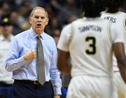 Only coach John Beilein's Michigan team, along with North Carolina and Villanova, has reached the national championship game twice in the past six seasons.