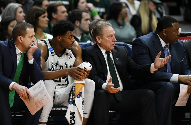 Michigan State head coach Tom Izzo, right, talks with Xavier Tillman during the Minnesota game.