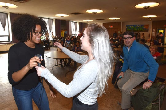 Detroit Area Youth Uniting Michigan Chairwoman and event organizer Brooke Solomon, left, of Detroit, hugs membership executive Meghan Biernat, right, of Sterling Heights, during the open mic session of the one-year anniversary of the March for Our Lives at First Unitarian-Universalist Church 'Cass Corridor Commons, Sunday, March 24, 2019. Last year, ten thousand youth activists and adults marched along the Detroit River and Woodward Avenue to demand solutions to gun violence and mass shootings as a sister march to the one held in DC by students from Stoneman-Douglass High School.