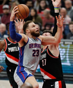 Detroit Pistons forward Blake Griffin, left, shoots as Portland Trail Blazers center Jusuf Nurkic defends during the first half Saturday, March 23, 2019, in Portland, Ore. The Trail Blazers defeated the Pistons, 117-112.
