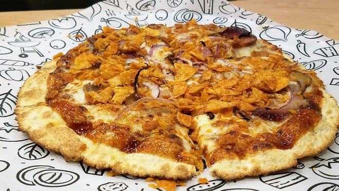 The West Sider pizza (the E'vil Pig in other cities) from Azzip Pizza, topped with pulled pork, crushed Grippo's and reduced Ski soda.