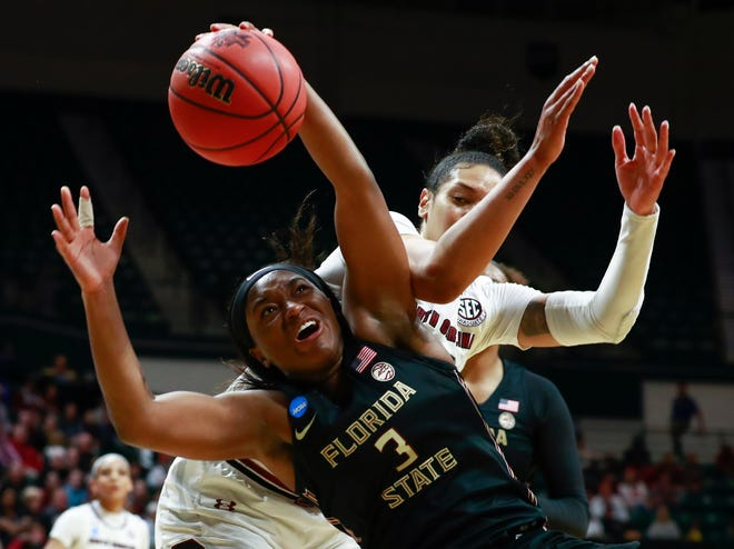 Florida State guard Sayawni Lassiter (3) battles for the ball during the second round of the NCAA Tournament in Charlotte, N.C.