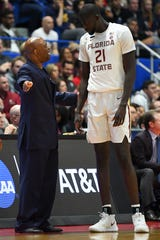 FSU head coach Leonard Hamilton talks with center Christ Koumadje during the first half of a game against Murray State  in the second round of the 2019 NCAA Tournament at XL Center.