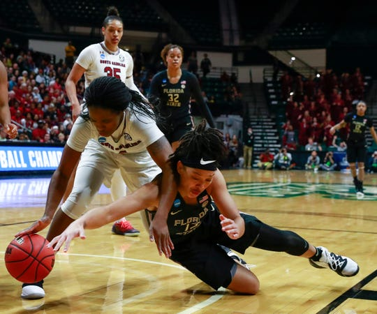 Florida State guard Nausla Woolfolk battles for a loose ball with South Carolina guard Doniyah Cliney during the second round of the NCAA Tournament in Charlotte, N.C.