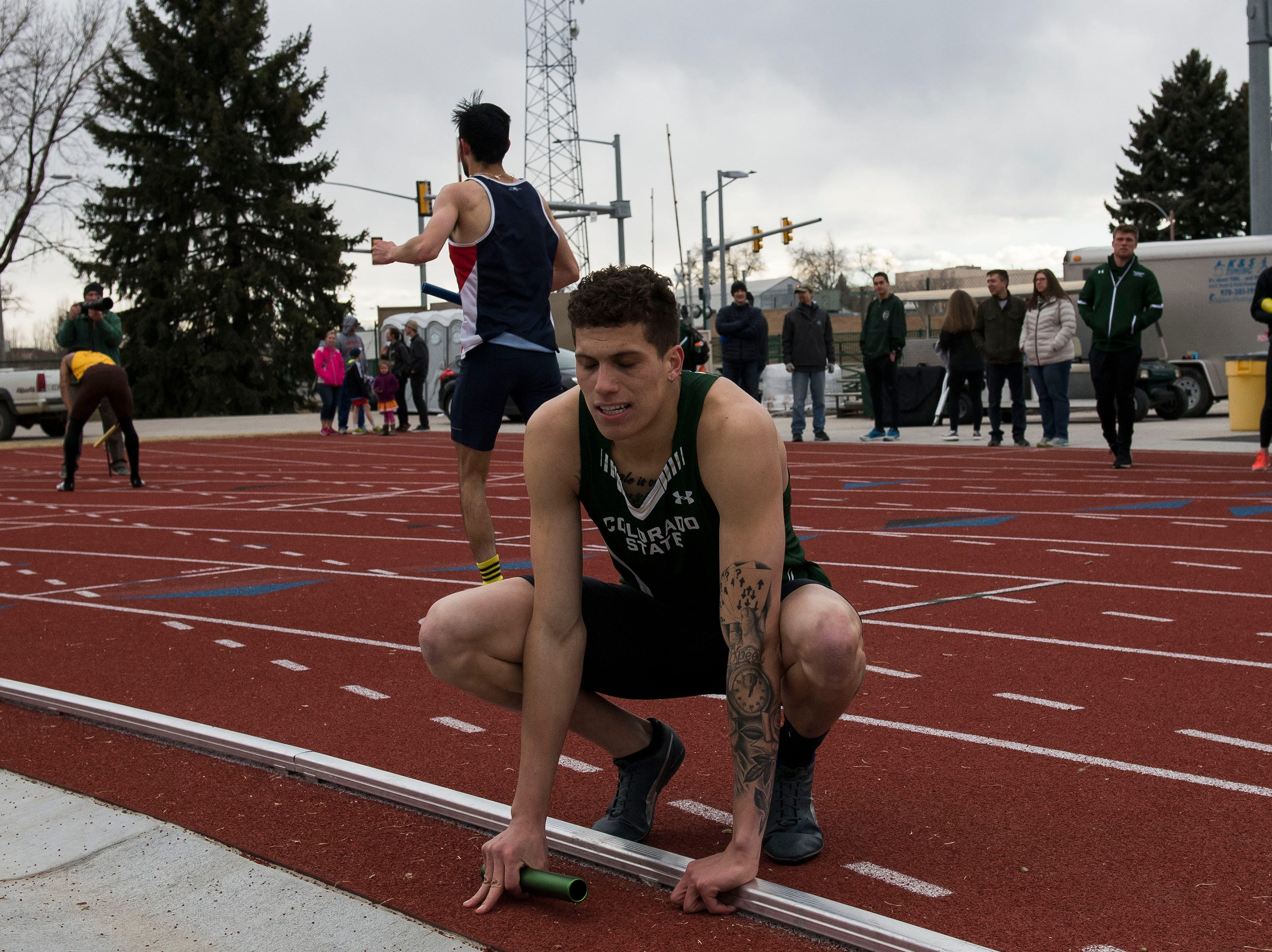 Colorado State University sophomore Caleb Hardy reacts after narrowly losing to University of Wyoming in the mens 4x400-meter relay on Saturday, March 23, 2019, at the Jack Christiansen Memorial Track in Fort Collins, Colo.