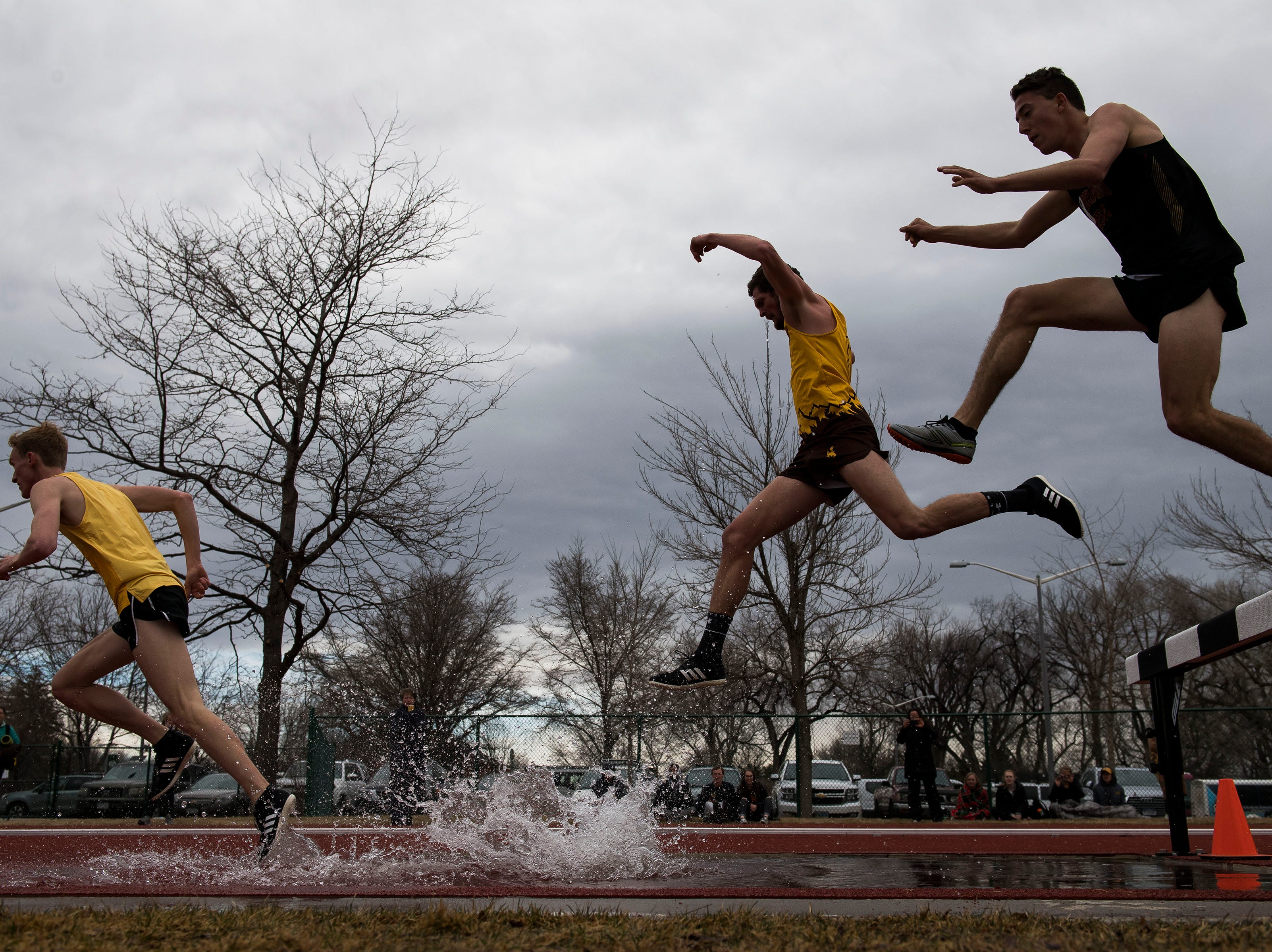 Runners from the University of Wyoming and Colorado Mesa compete I the mens 3000-meter steeple chase on Saturday, March 23, 2019, at the Jack Christiansen Memorial Track in Fort Collins, Colo.