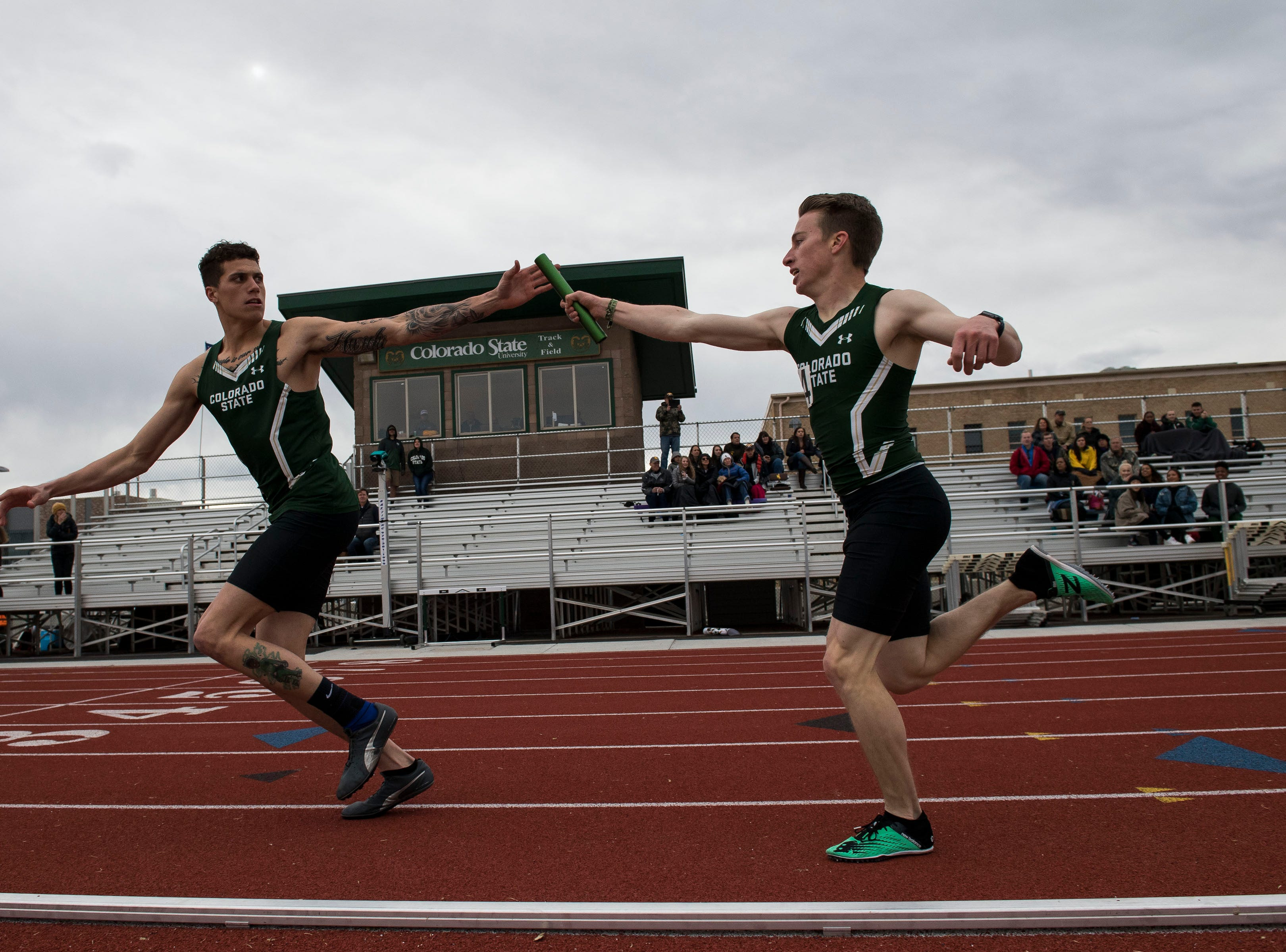 Colorado State University sophomore Caleb Hardy takes the handoff from Nick Fondiller in the mens 4x400-meter relay on Saturday, March 23, 2019, at the Jack Christiansen Memorial Track in Fort Collins, Colo.