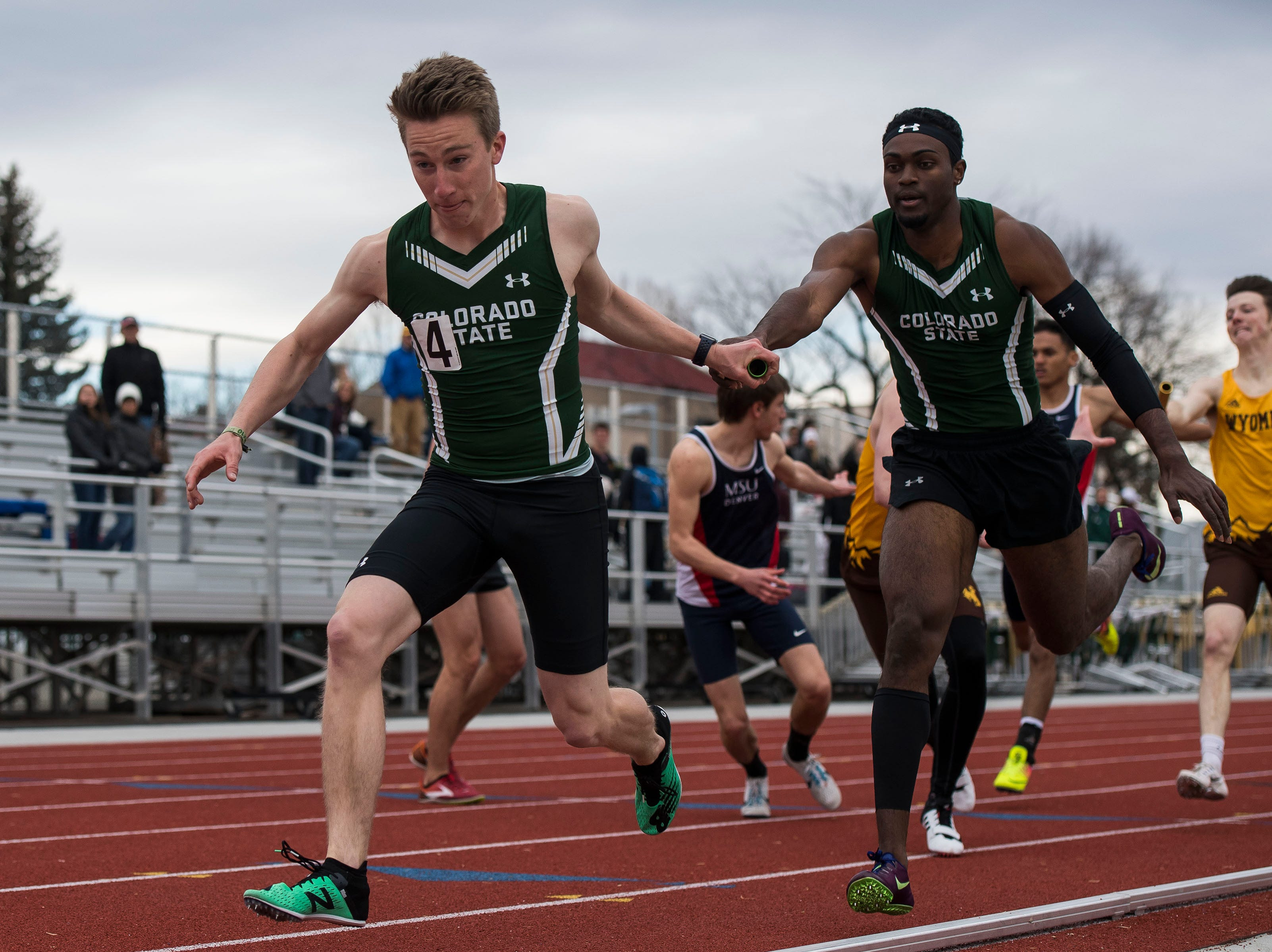 Colorado State University junior Nick Fondiller takes the handoff from Kamal-Craig Golaube during the mens 4x400-meter relay on Saturday, March 23, 2019, at the Jack Christiansen Memorial Track in Fort Collins, Colo.