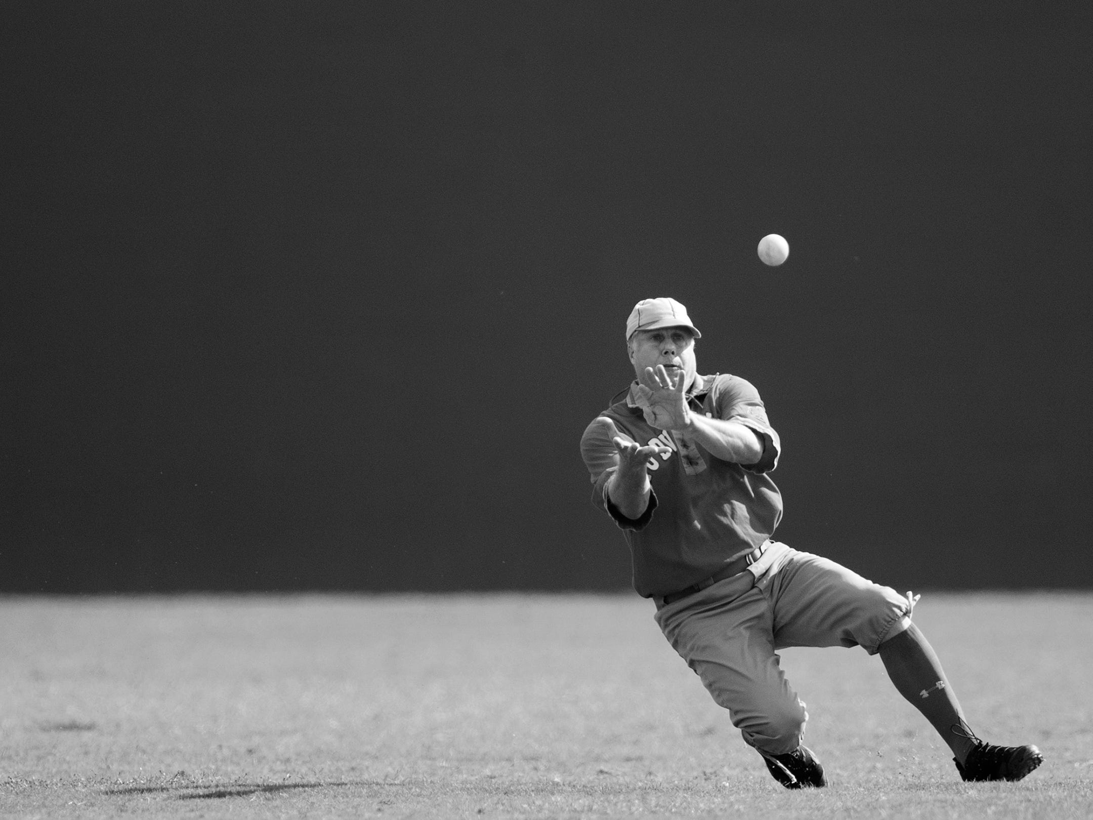 "Mike ""Bull"" McKenna of the Mudville Base Bull Club makes a catch against the Springfield Long Nine on Sunday at Terry Park in Fort Myers. Vintage baseball teams from throughout the country competed in the event presented by the Edison and Ford Winter Estates."