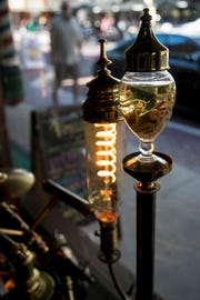 Lamps made by artist Steve Timcak adorn the windows of his store, Timeless, in downtown Fort Myers.