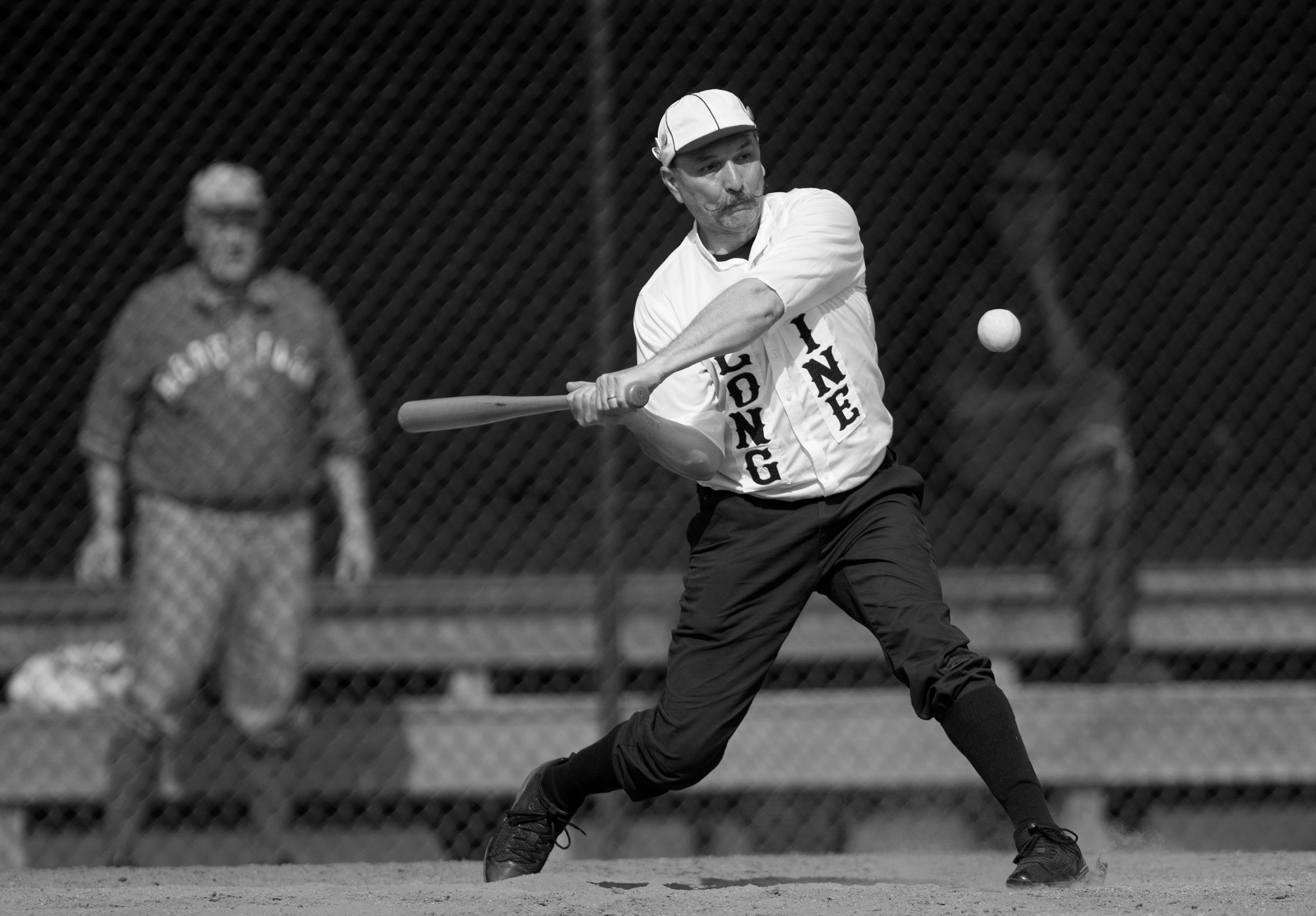"Tim ""Super D"" DeSherlia of the Springfield Long Nine plays against the Mudville Base Ball Club on Sunday at Terry Park in Fort Myers. Vintage baseball teams from throughout the country competed in the event presented by the Edison and Ford Winter Estates."