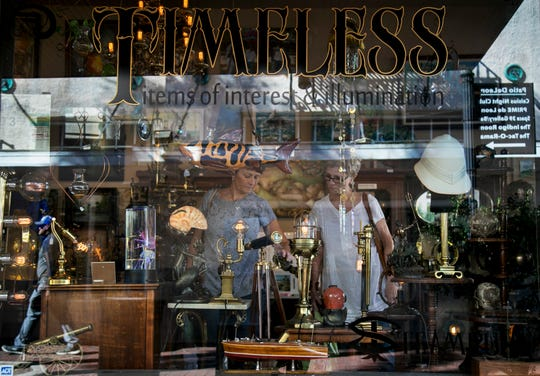 Karen Stinson and Carolyn DeMaggio shop at Timeless in downtown Fort Myers.