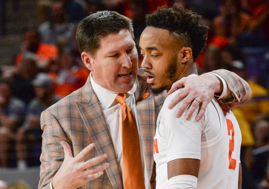 Clemson head coach Brad Brownell talks to Clemson guard Marcquise Reed (2) late in the second half in the second round of the NIT at Littlejohn Coliseum in Clemson Sunday, March 24, 2019.