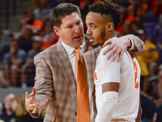 Clemson head coach Brad Brownell  talks with Clemson guard Marcquise Reed (2) late during the second half in the second round of the NIT at Littlejohn Coliseum in Clemson Sunday, March 24, 2019.