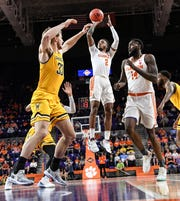 Clemson guard Marcquise Reed (2) shoots near Wichita State center Asbjorn Midtgaard(33) during the first half in the second round of the NIT at Littlejohn Coliseum in Clemson Sunday, March 24, 2019.