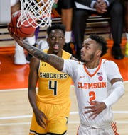 Clemson guard Marcquise Reed (2) shoots near Wichita State guard Samajae Haynes-Jones(4) during the first half in the second round of the NIT at Littlejohn Coliseum in Clemson Sunday, March 24, 2019.