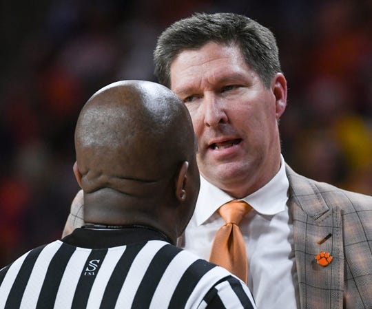 Clemson head coach Brad Brownell  talks with a referee during the second half in the second round of the NIT at Littlejohn Coliseum in Clemson Sunday, March 24, 2019.