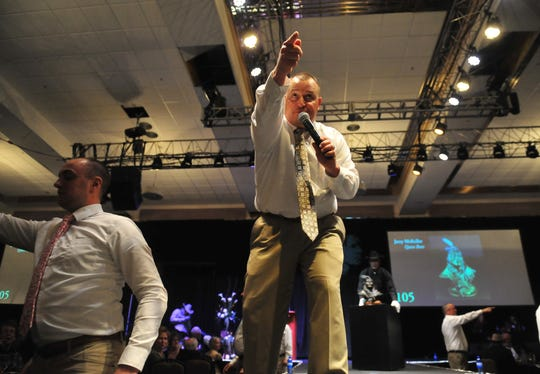 Auctioneer Troy Black makes a sale during The Russell Live Auction on Saturday night in the Great Falls Civic Auditorium.