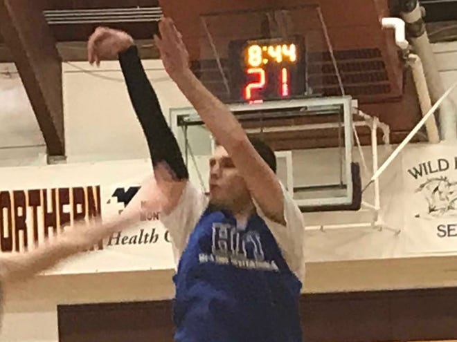 Choteau's Sayer Patton, playing for the Class B Boys, launches a 3-pointer in his Saturday pool game against the Class AA squad.