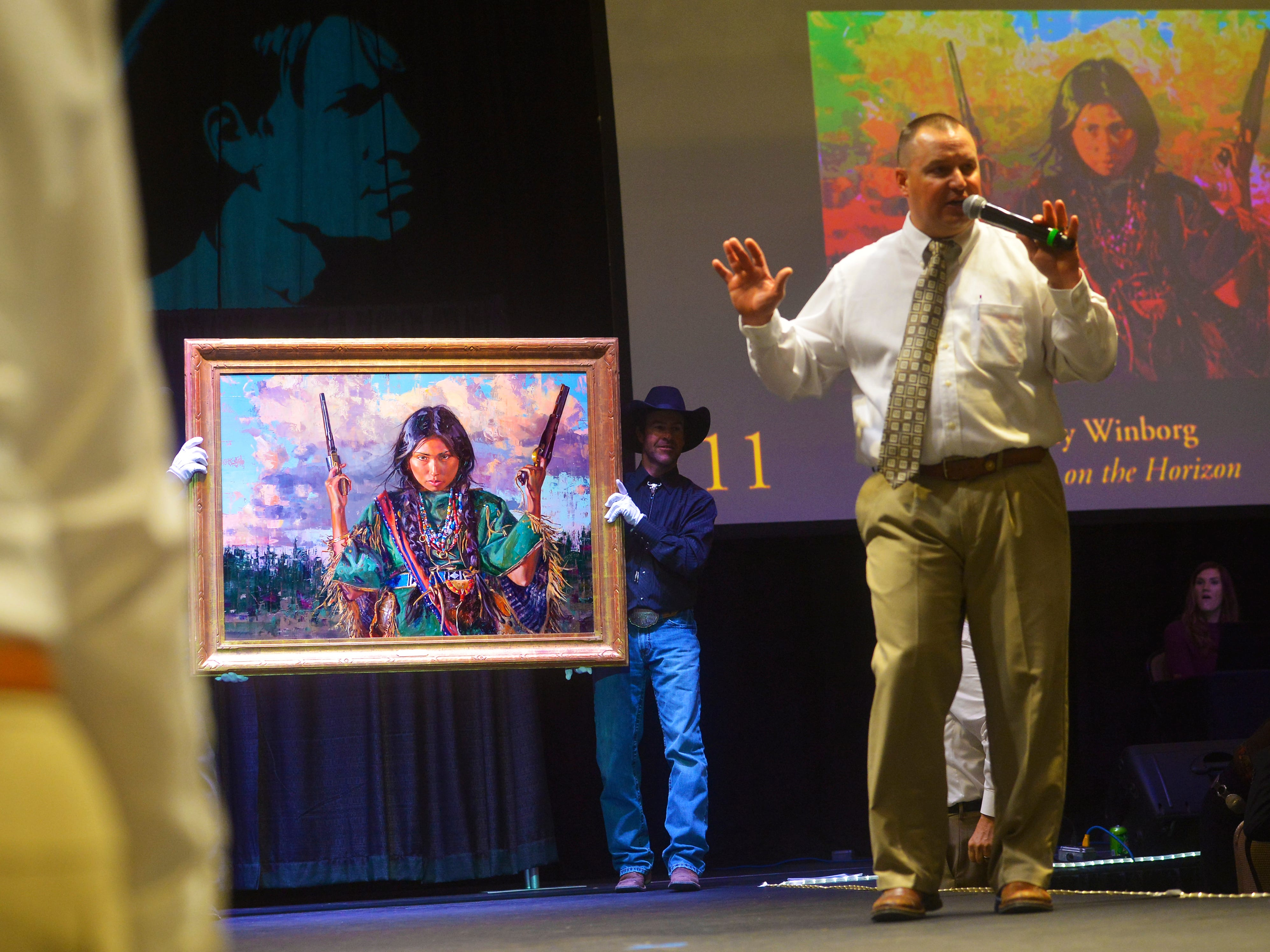 "Jeremy Winborg's ""A Storm on the Horizon"" sold for $40,000 during the Russell Live Auction on Saturday night in the Great Falls Civic Auditorium."