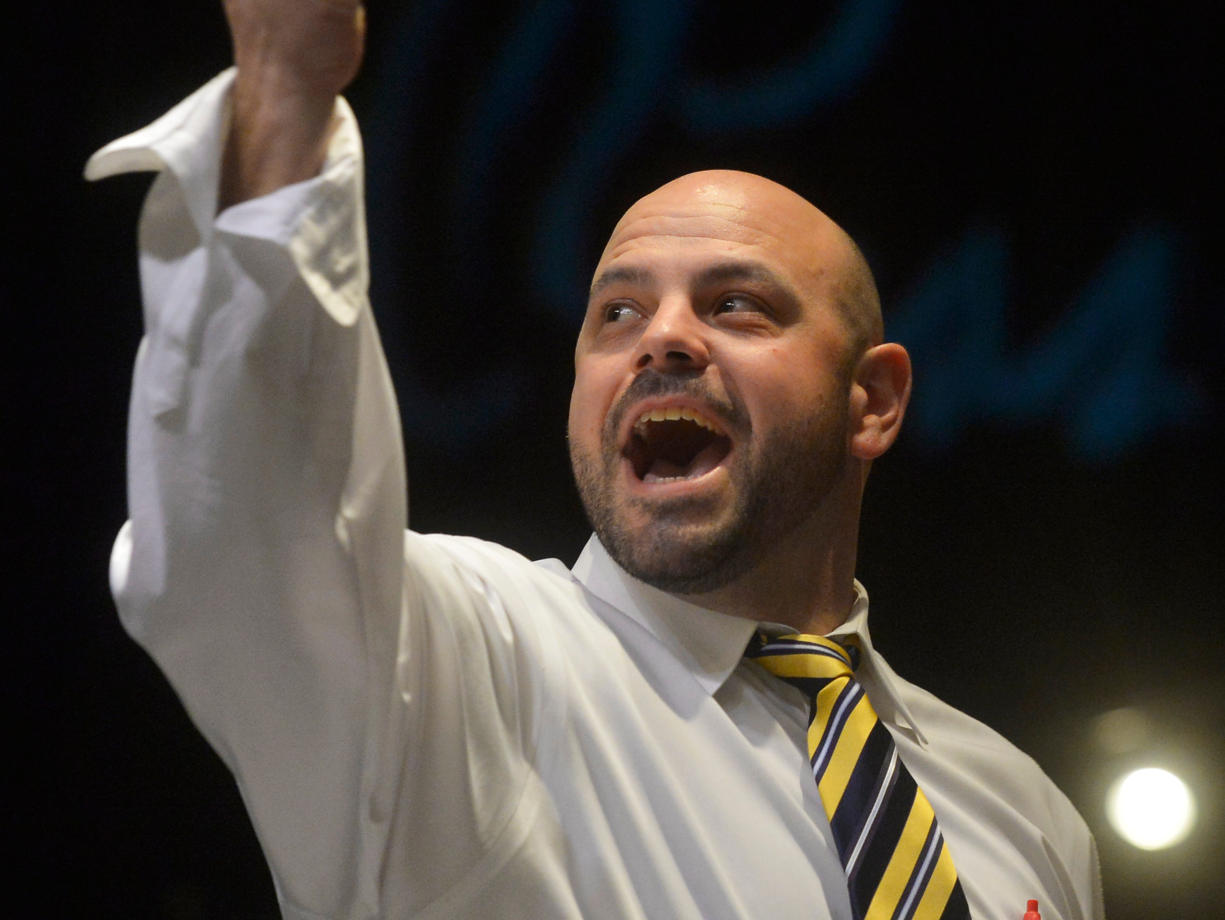 A spotter with Black and Associates Auctioneers calls out a bid during The Russell Live Auction on Saturday night in the Great Falls Civic Auditorium.