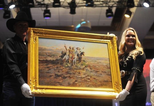 "C.M.Russell's ""Approach of White Men"" sells for $1.2 million during The Russell Live Auction on Saturday night in the Great Falls Civic Auditorium."