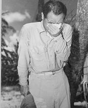 An Japanese prisoner of war on Guam, with bowed head after hearing Emperor Hirohito makes the announcement of Japan's unconditional surrender in August 1945.