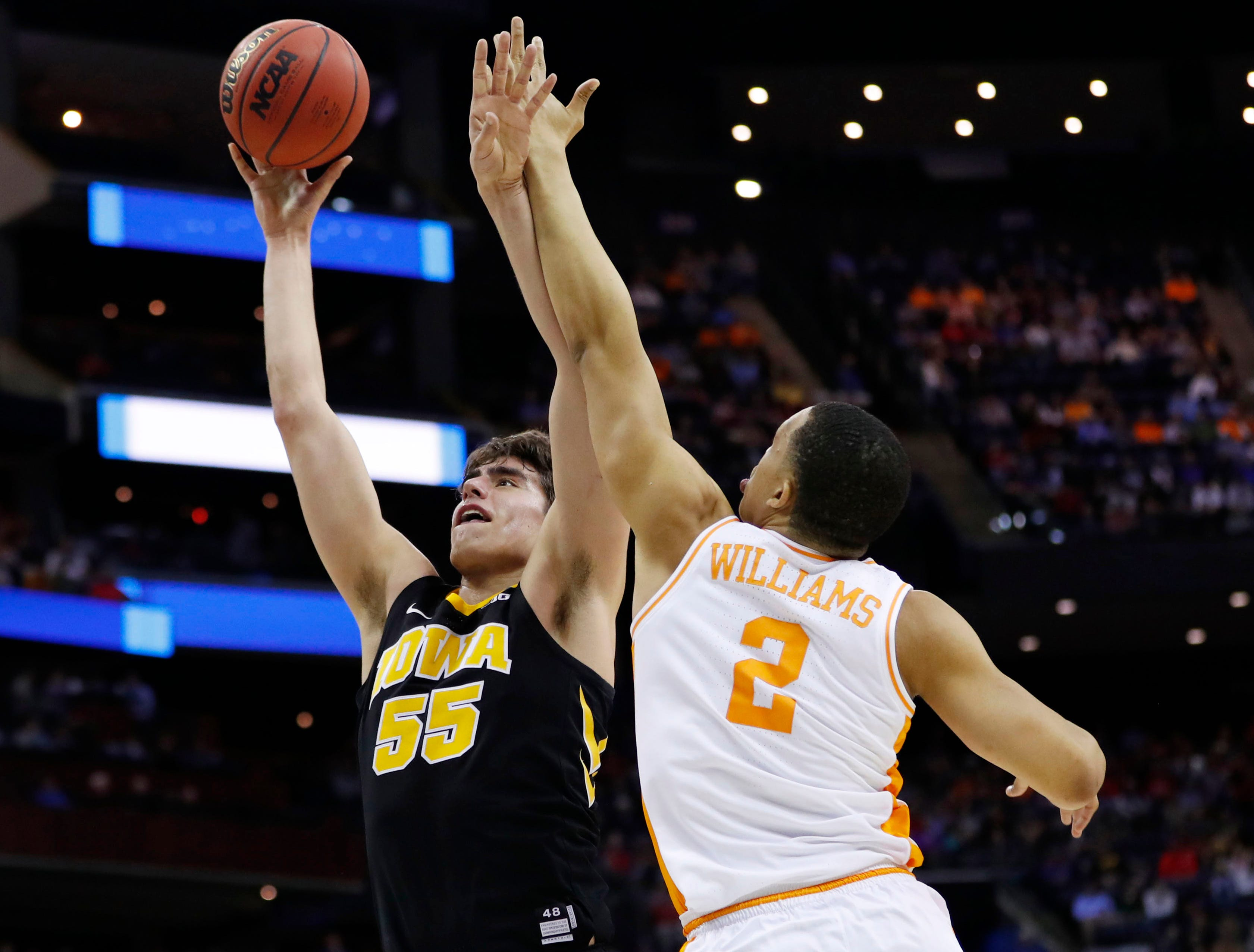 Iowa Hawkeyes forward Luka Garza (55) goes to the basket defended by Tennessee Volunteers forward Grant Williams (2) in the first half in the second round of the 2019 NCAA Tournament at Nationwide Arena.