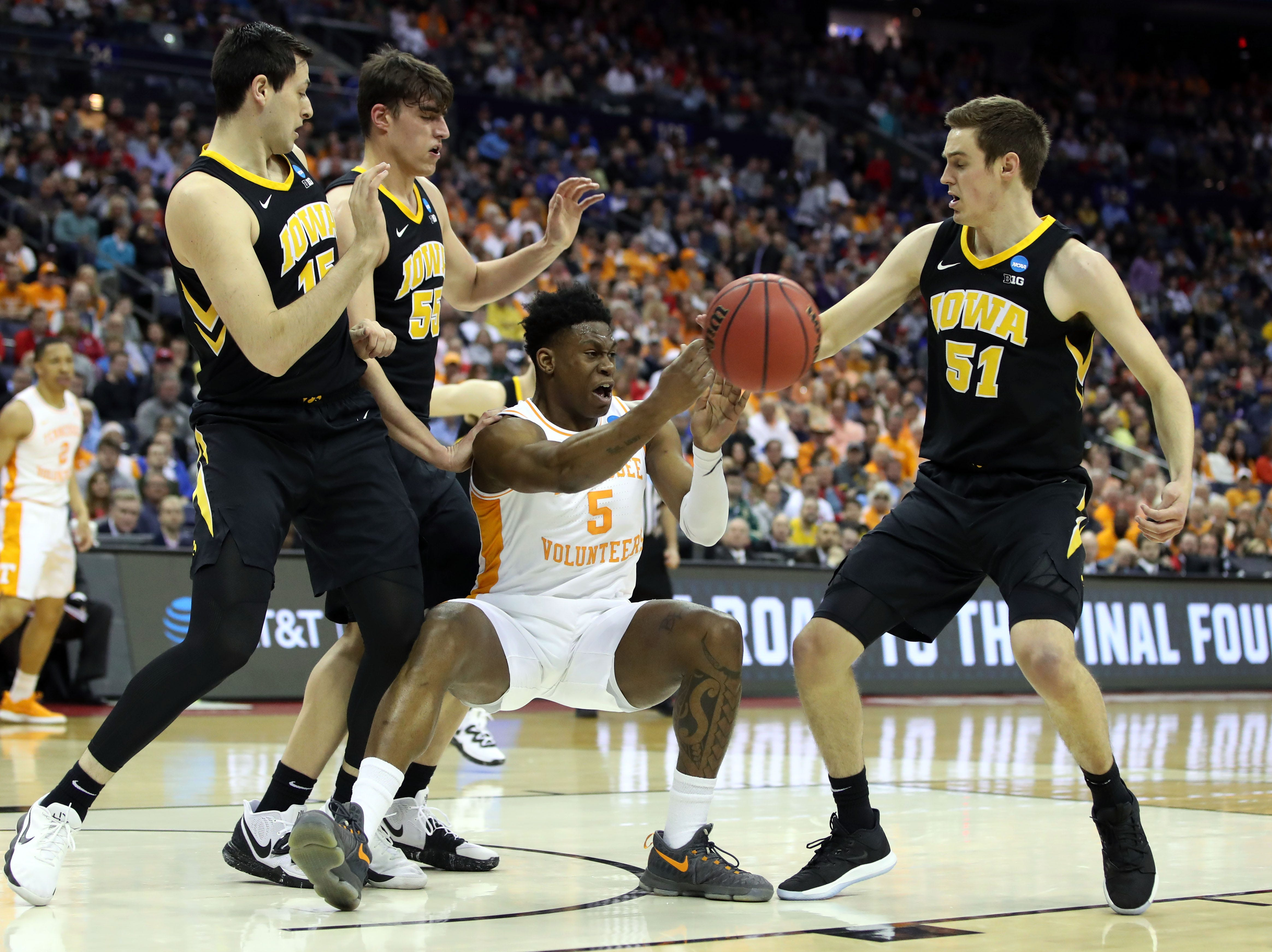 Tennessee Volunteers guard Admiral Schofield (5) passes the ball surrounded by Iowa Hawkeyes forward Ryan Kriener (15) forward Luka Garza (55) and forward Nicholas Baer (51) in the second round of the 2019 NCAA Tournament at Nationwide Arena.