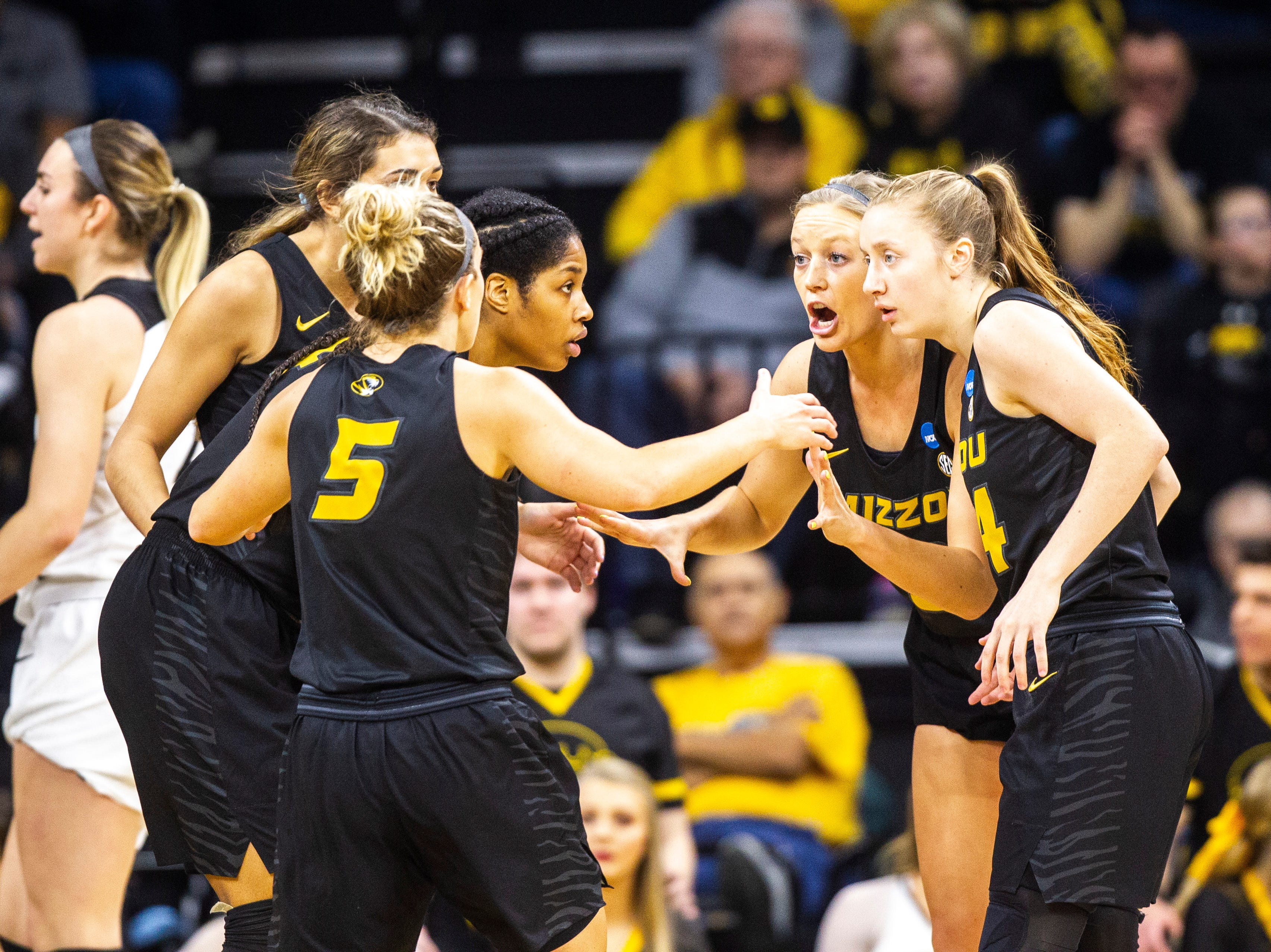Missouri guard Sophie Cunningham, second from right, huddles with teammates during a NCAA women's basketball tournament second-round game, Sunday, March 24, 2019, at Carver-Hawkeye Arena in Iowa City, Iowa.