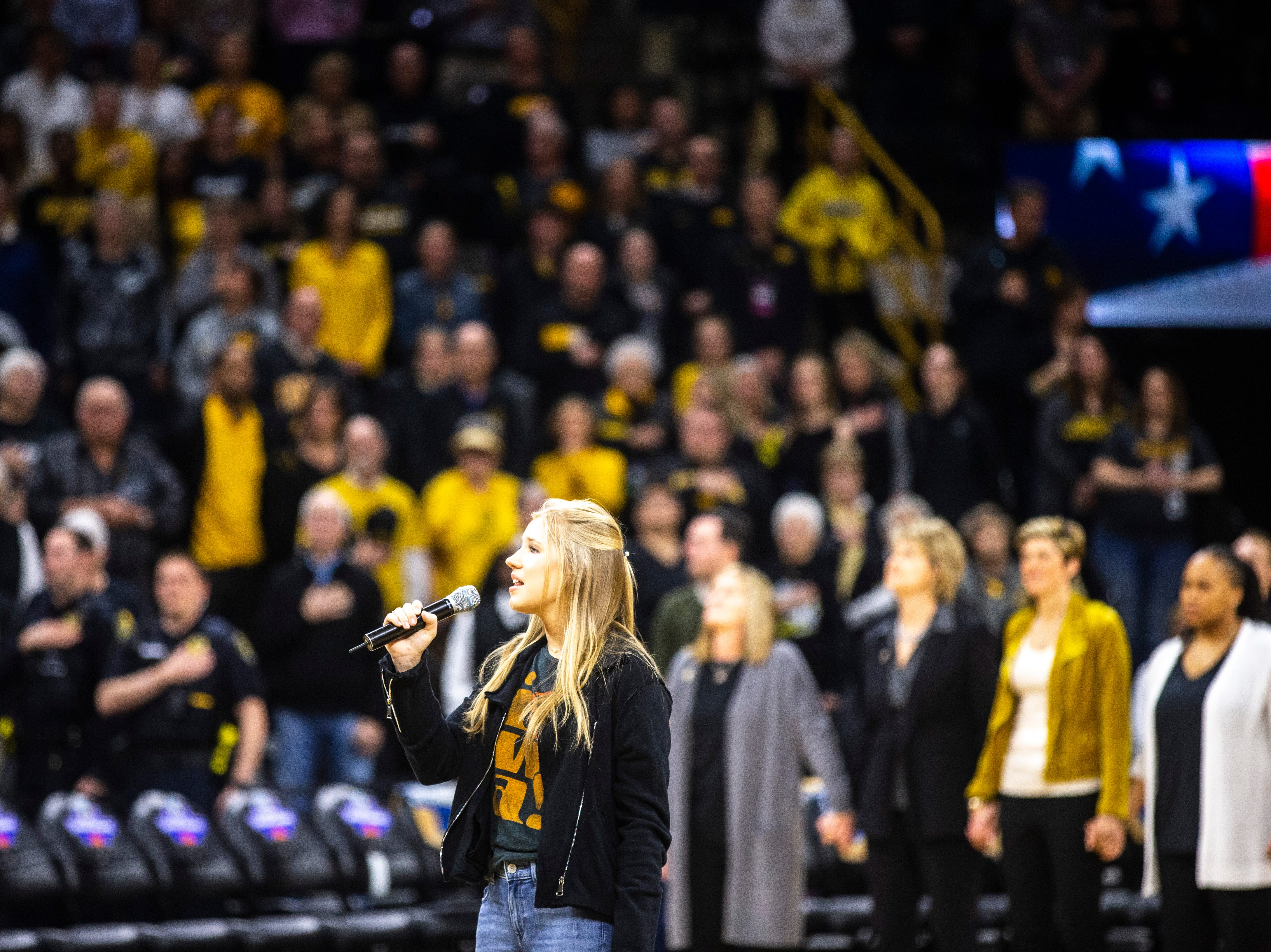 Emma Bluder, the daughter of Iowa head coach Lisa Bluder, sings the national anthem during a NCAA women's basketball tournament second-round game, Sunday, March 24, 2019, at Carver-Hawkeye Arena in Iowa City, Iowa.