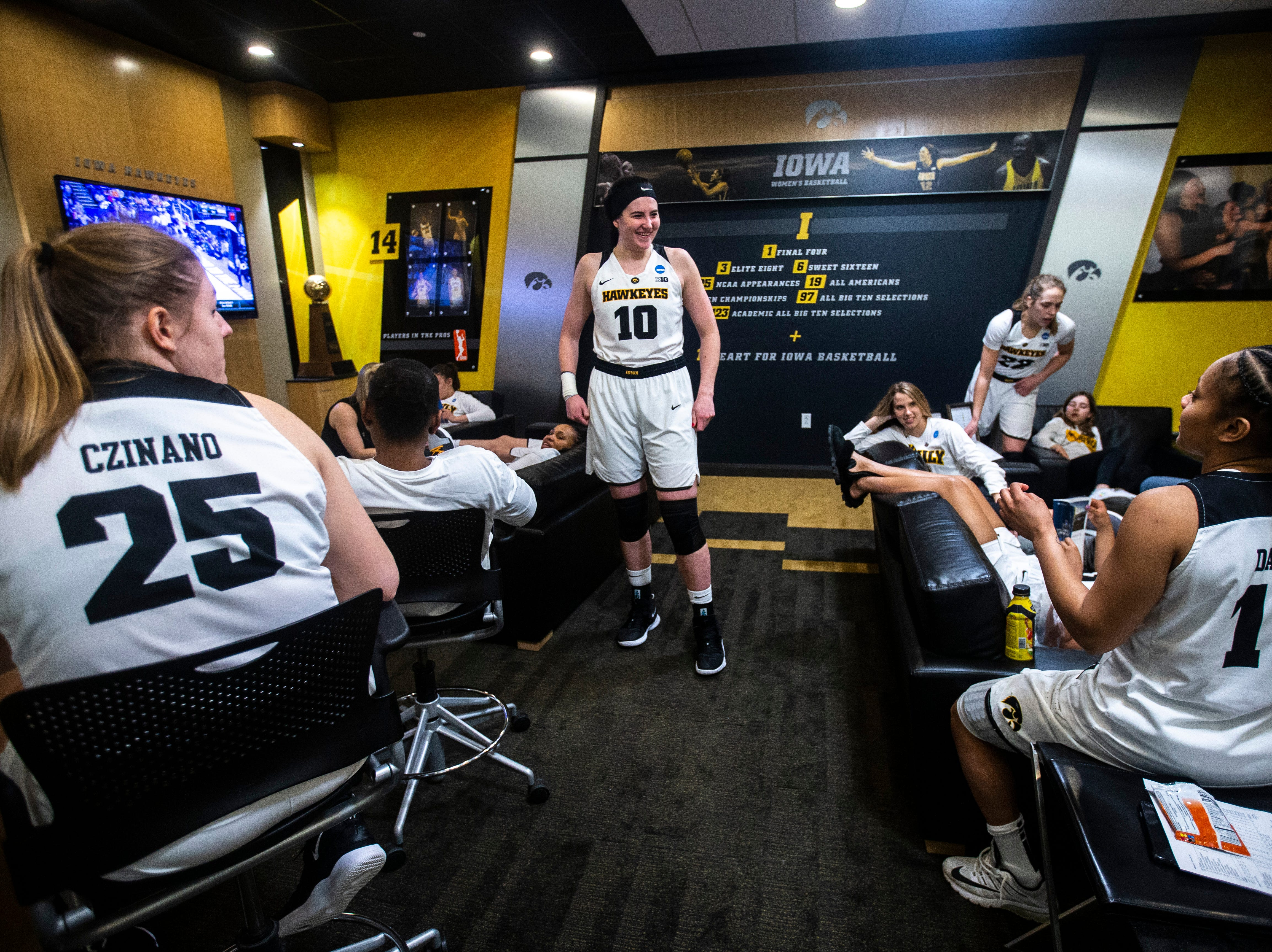 Iowa center Megan Gustafson (10) talks with Iowa guard Tania Davis (11) after returning back to the locker room after a NCAA women's basketball tournament second-round game, Sunday, March 24, 2019, at Carver-Hawkeye Arena in Iowa City, Iowa.