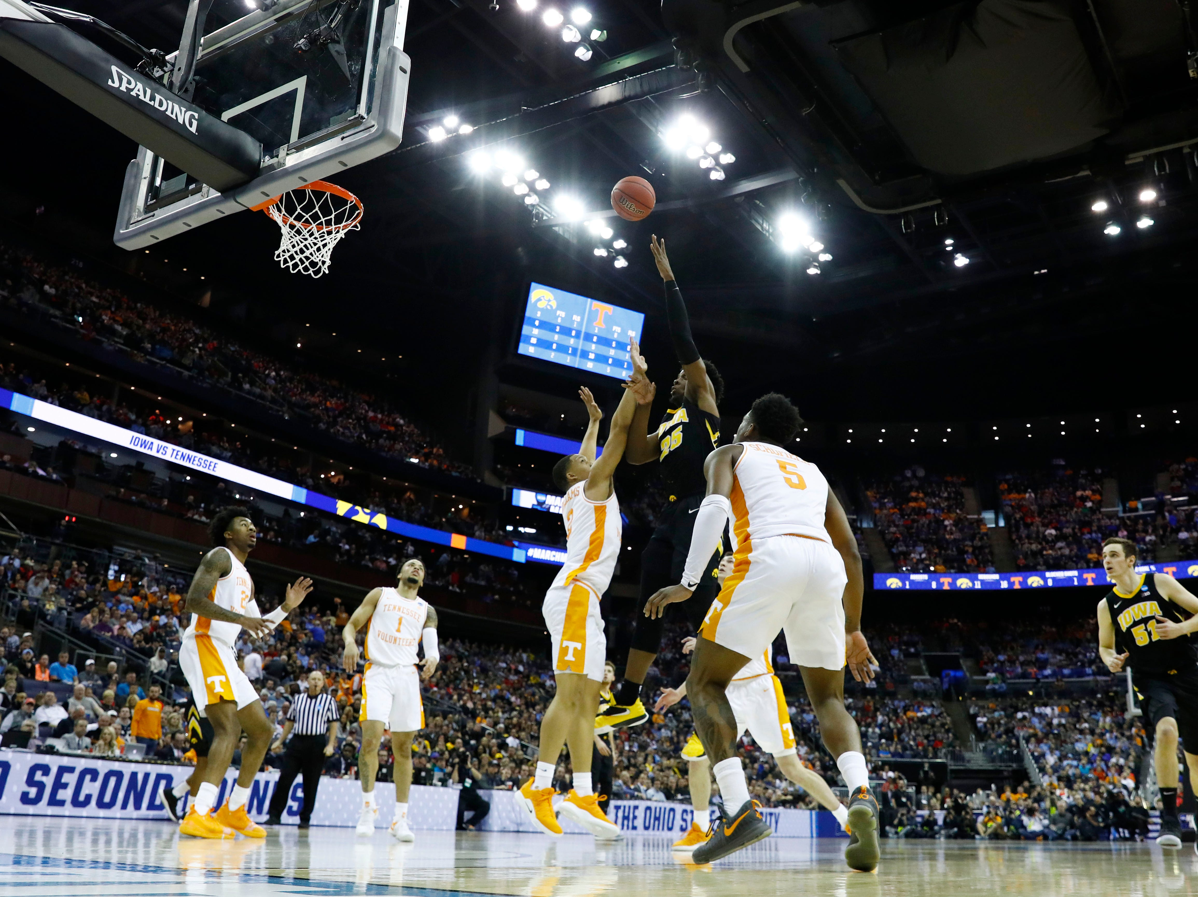 Iowa Hawkeyes forward Tyler Cook (25) shoots the ball over Tennessee Volunteers forward Grant Williams (2) in the first half in the second round of the 2019 NCAA Tournament at Nationwide Arena.