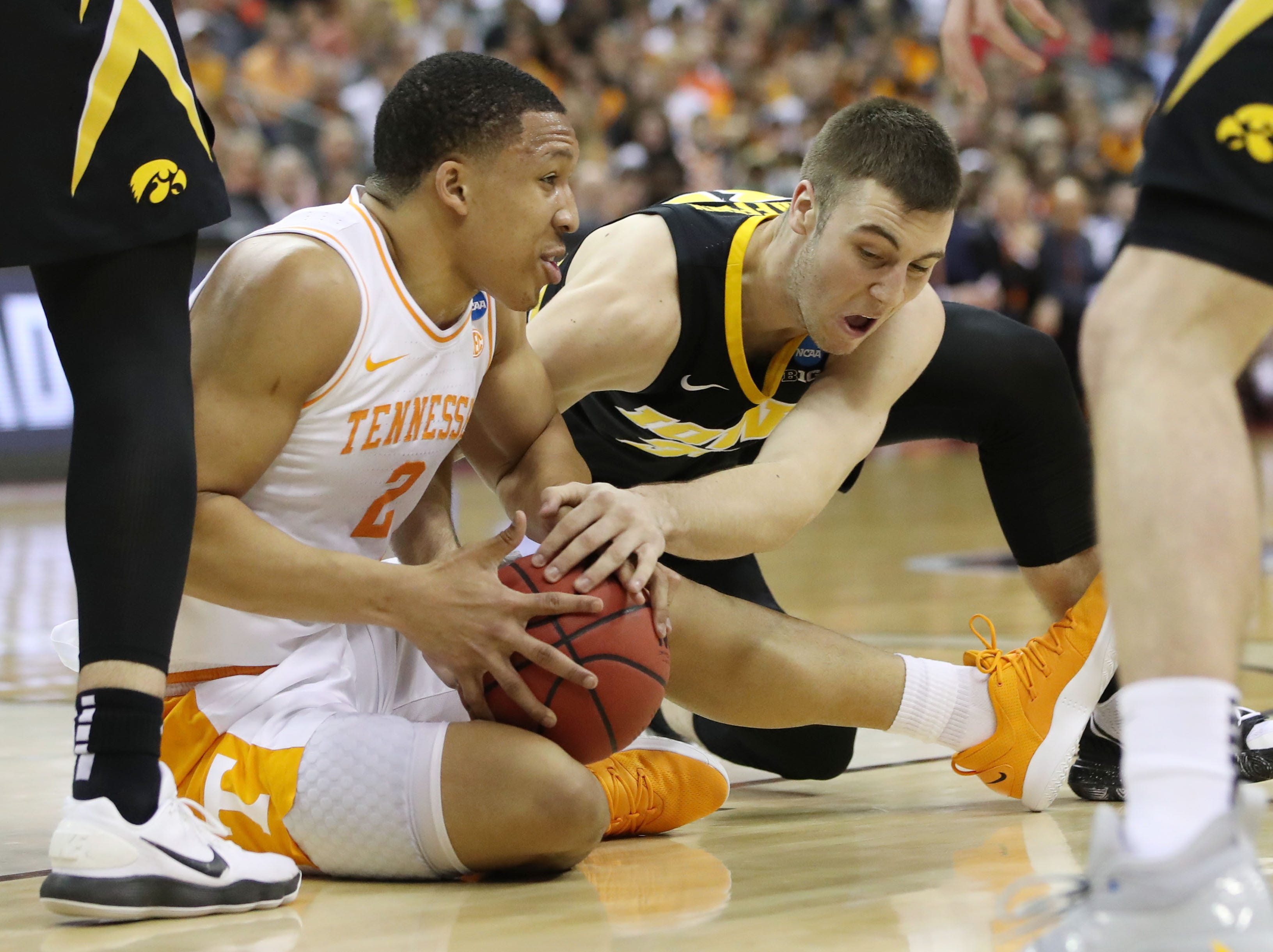 Tennessee Volunteers forward Grant Williams (2) and Iowa Hawkeyes guard Connor McCaffery (30) battle for the ball in the first half in the second round of the 2019 NCAA Tournament at Nationwide Arena.