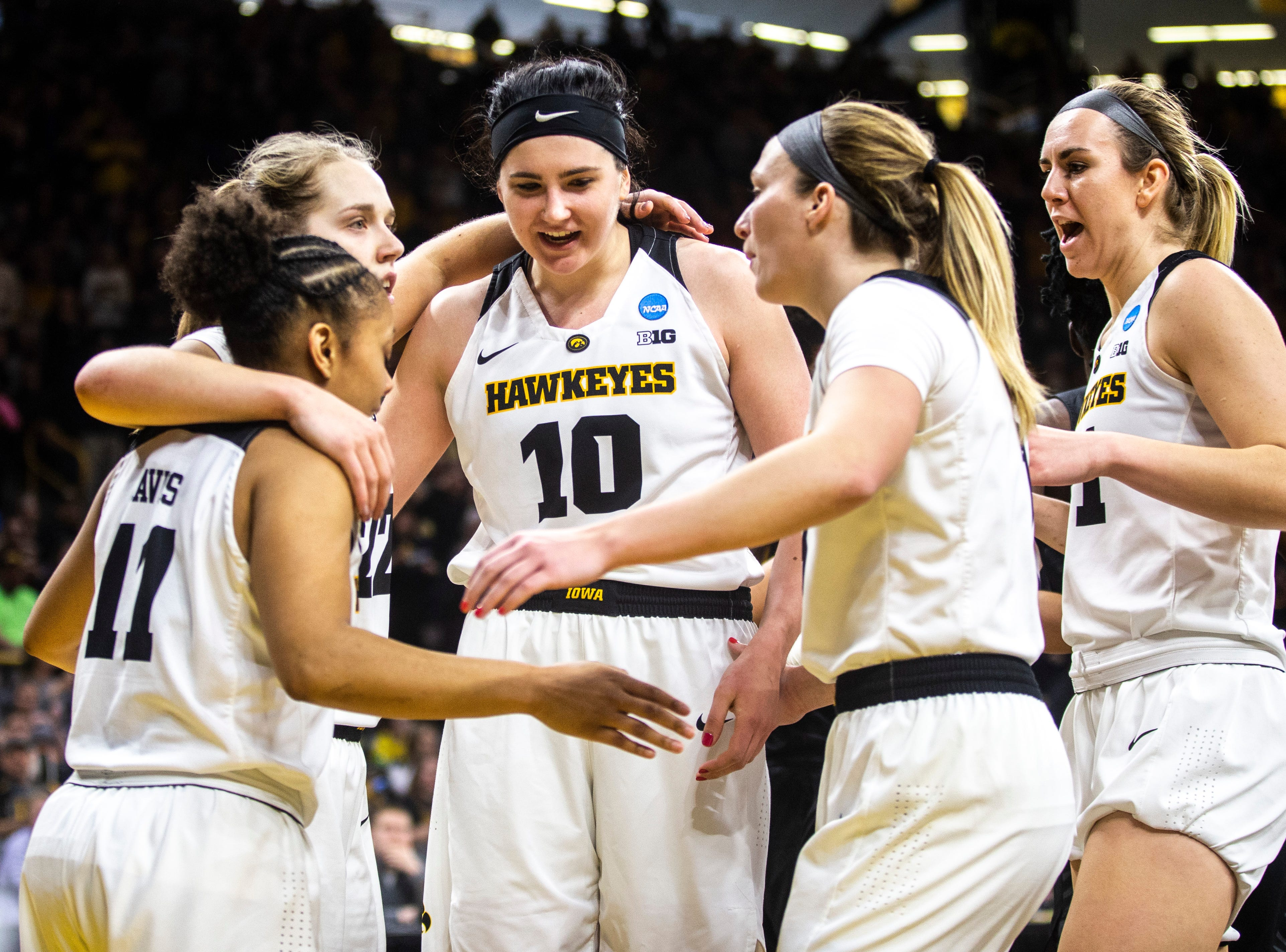 Iowa center Megan Gustafson (10) huddles with teammates  during a NCAA women's basketball tournament second-round game, Sunday, March 24, 2019, at Carver-Hawkeye Arena in Iowa City, Iowa.