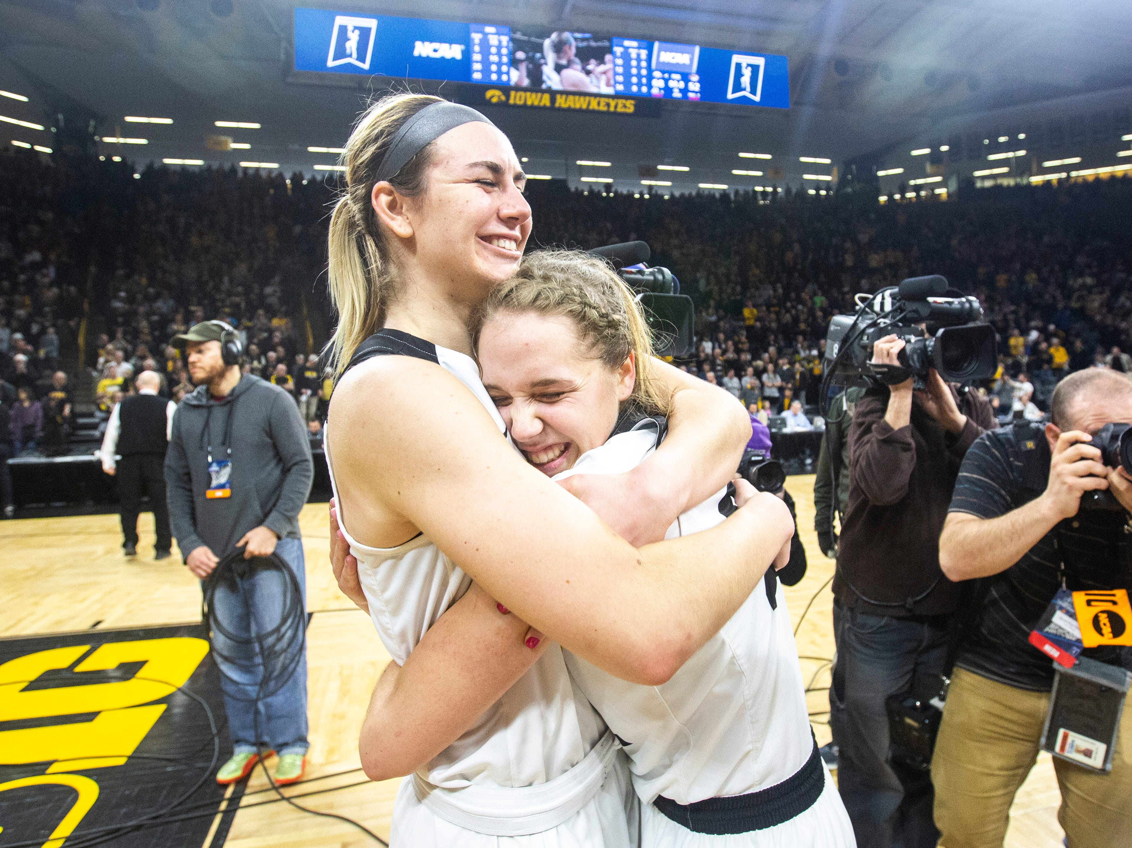 Iowa forward Hannah Stewart, left, embraces Iowa guard Kathleen Doyle during a NCAA women's basketball tournament second-round game, Sunday, March 24, 2019, at Carver-Hawkeye Arena in Iowa City, Iowa.