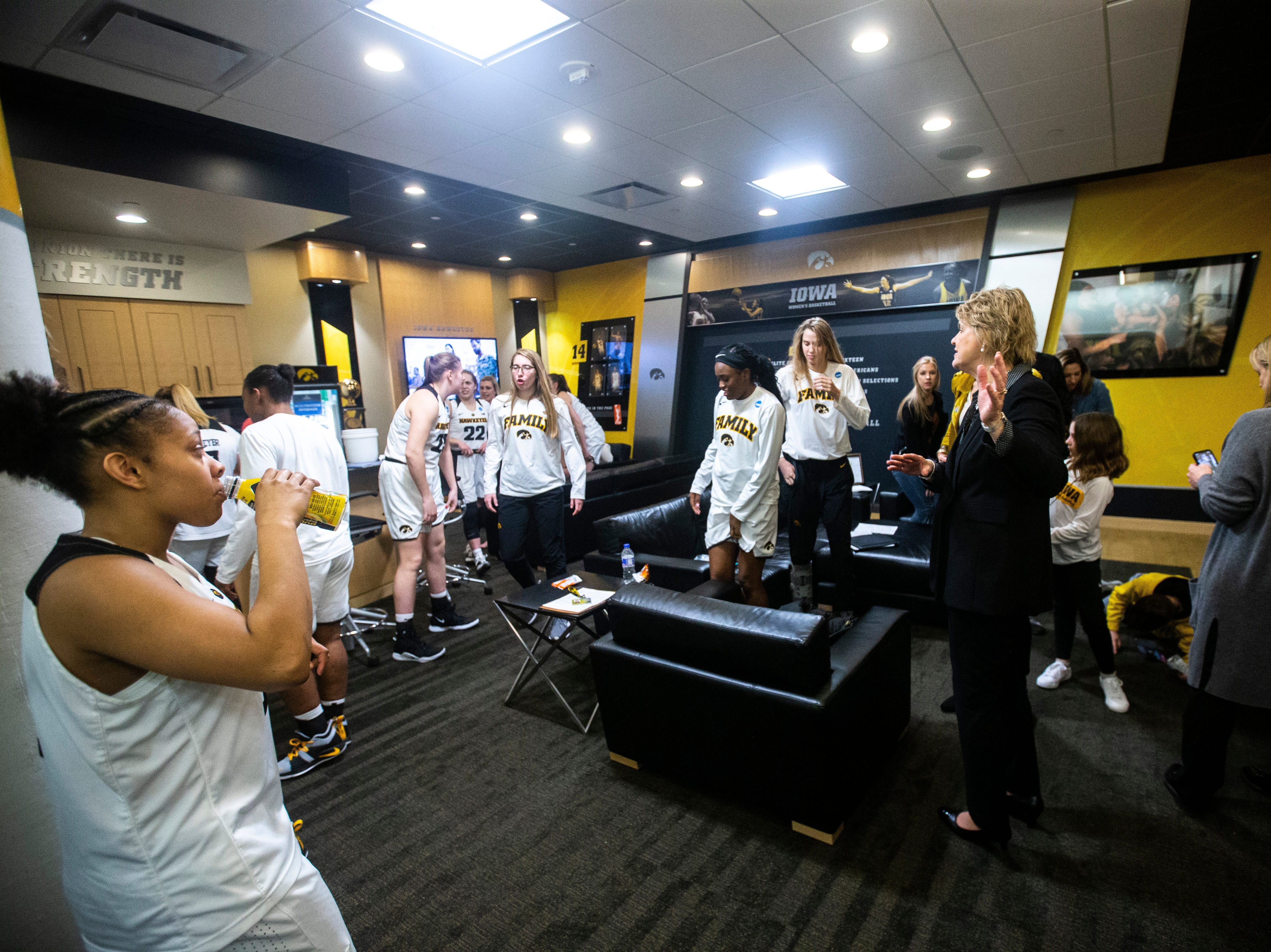 Iowa center Megan Gustafson (10) talks to players before cutting down the nets on the court after a NCAA women's basketball tournament second-round game, Sunday, March 24, 2019, at Carver-Hawkeye Arena in Iowa City, Iowa.