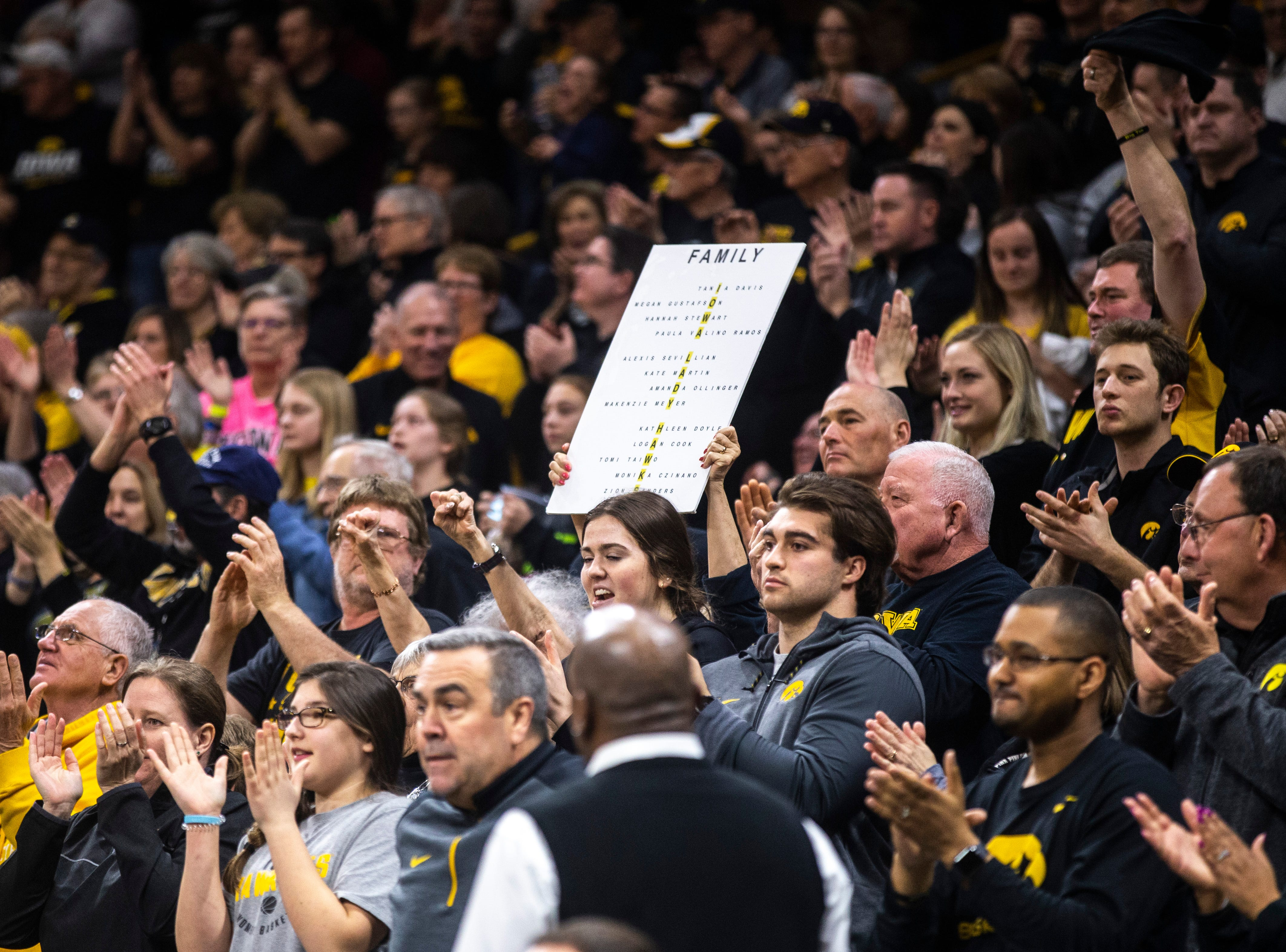 Iowa Hawkeyes fans hold up a sign that spells out the names of the players on the team during a NCAA women's basketball tournament second-round game, Sunday, March 24, 2019, at Carver-Hawkeye Arena in Iowa City, Iowa.