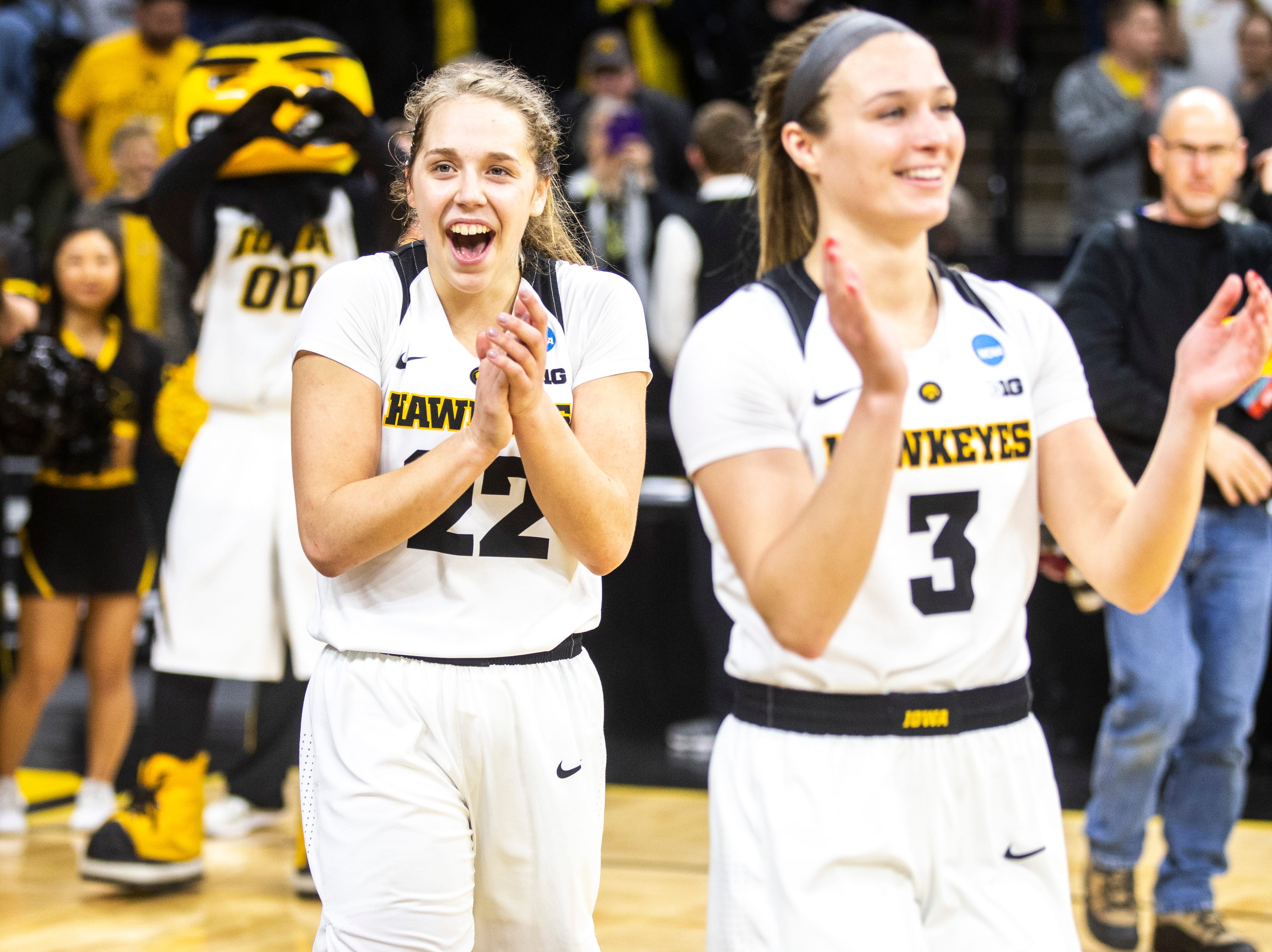Iowa guard Kathleen Doyle (22) and Iowa guard Makenzie Meyer (3) celebrate after a NCAA women's basketball tournament second-round game, Sunday, March 24, 2019, at Carver-Hawkeye Arena in Iowa City, Iowa.