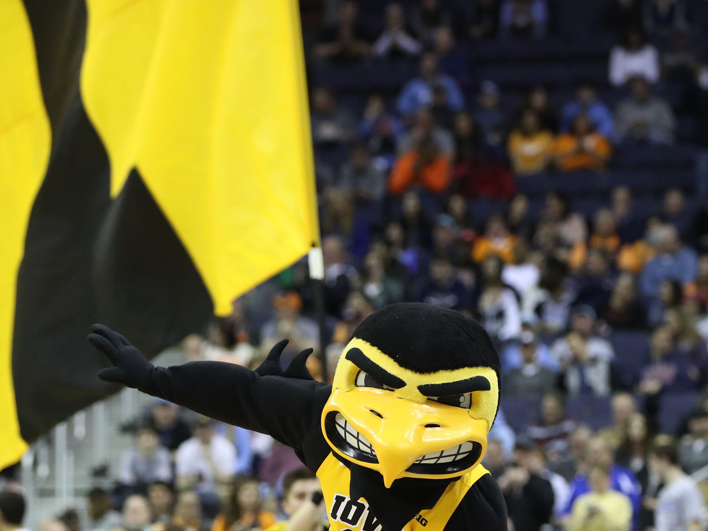 Iowa Hawkeyes mascot Herky the Hawk runs down the court before the game against the Tennessee Volunteers in the second round of the 2019 NCAA Tournament at Nationwide Arena.