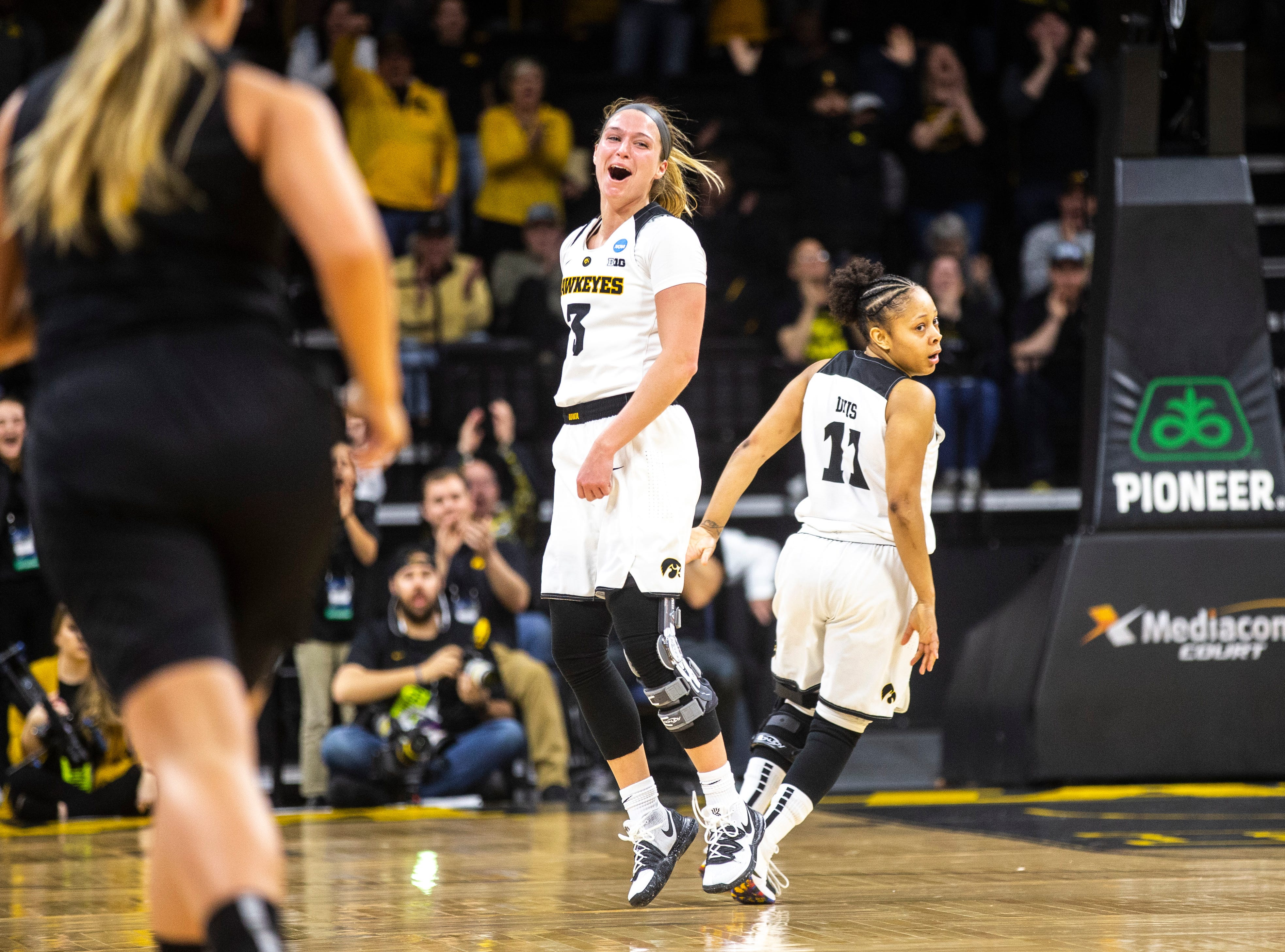 Iowa guard Makenzie Meyer (3) reacts after making a basket while settling in on defense with Iowa guard Tania Davis (11) during a NCAA women's basketball tournament second-round game, Sunday, March 24, 2019, at Carver-Hawkeye Arena in Iowa City, Iowa.