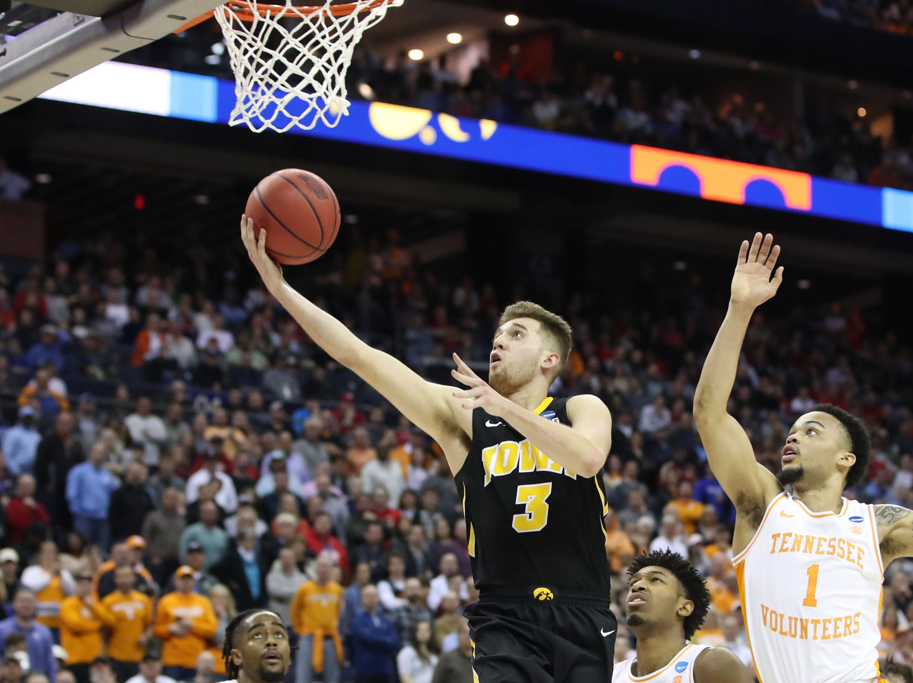 Iowa Hawkeyes guard Jordan Bohannon (3) goes to the basket defended by Tennessee Volunteers guard Lamonte Turner (1) in overtime  play in the second round of the 2019 NCAA Tournament at Nationwide Arena.