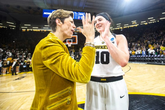 Megan Gustafson, right, is congratulated by assistant coach Jan Jensen after the Hawkeyes advanced to the Sweet 16 last month.