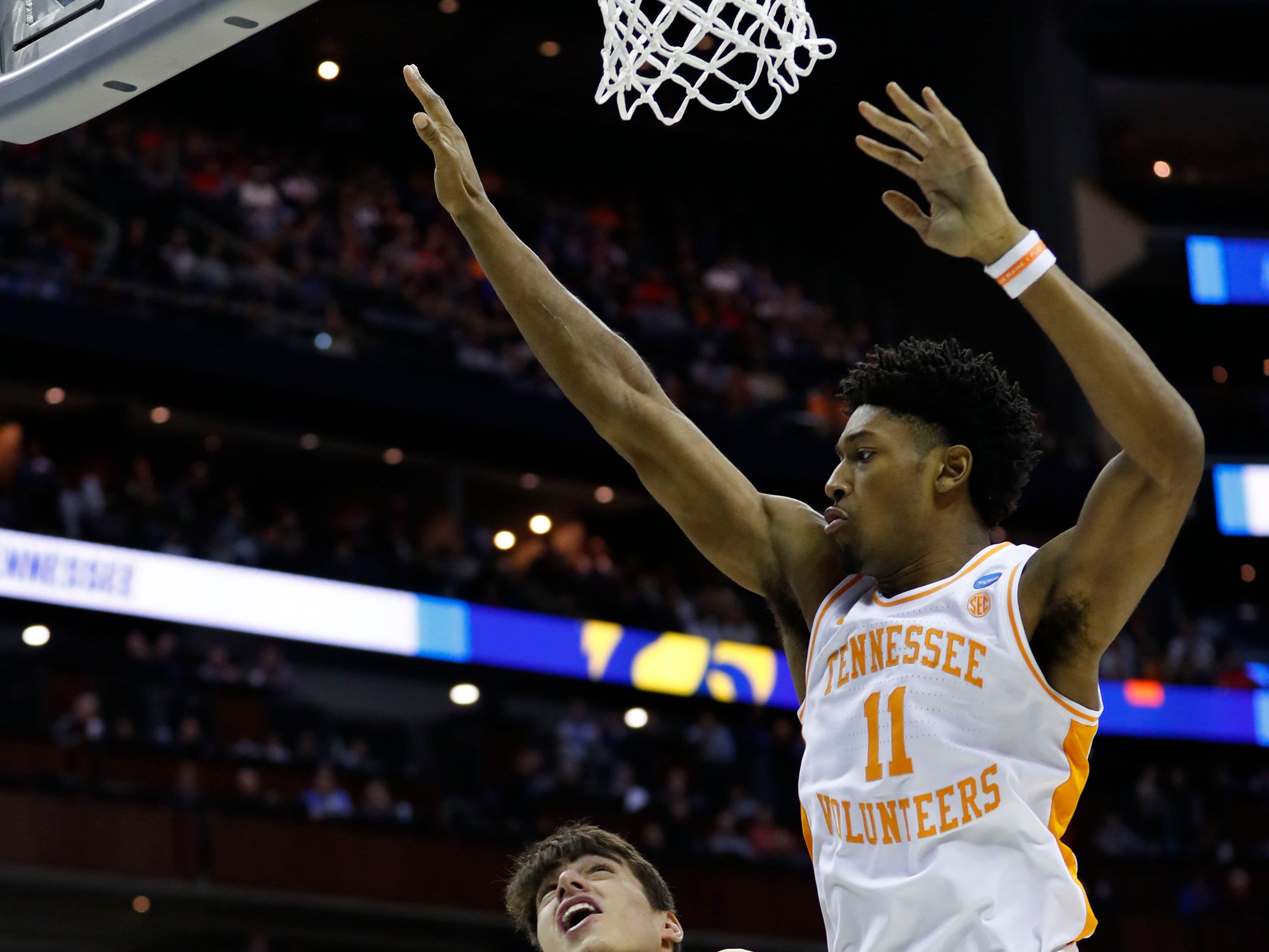 Tennessee Volunteers forward Kyle Alexander (11) jumps to defend Iowa Hawkeyes forward Luka Garza (55) in the first half in the second round of the 2019 NCAA Tournament at Nationwide Arena.