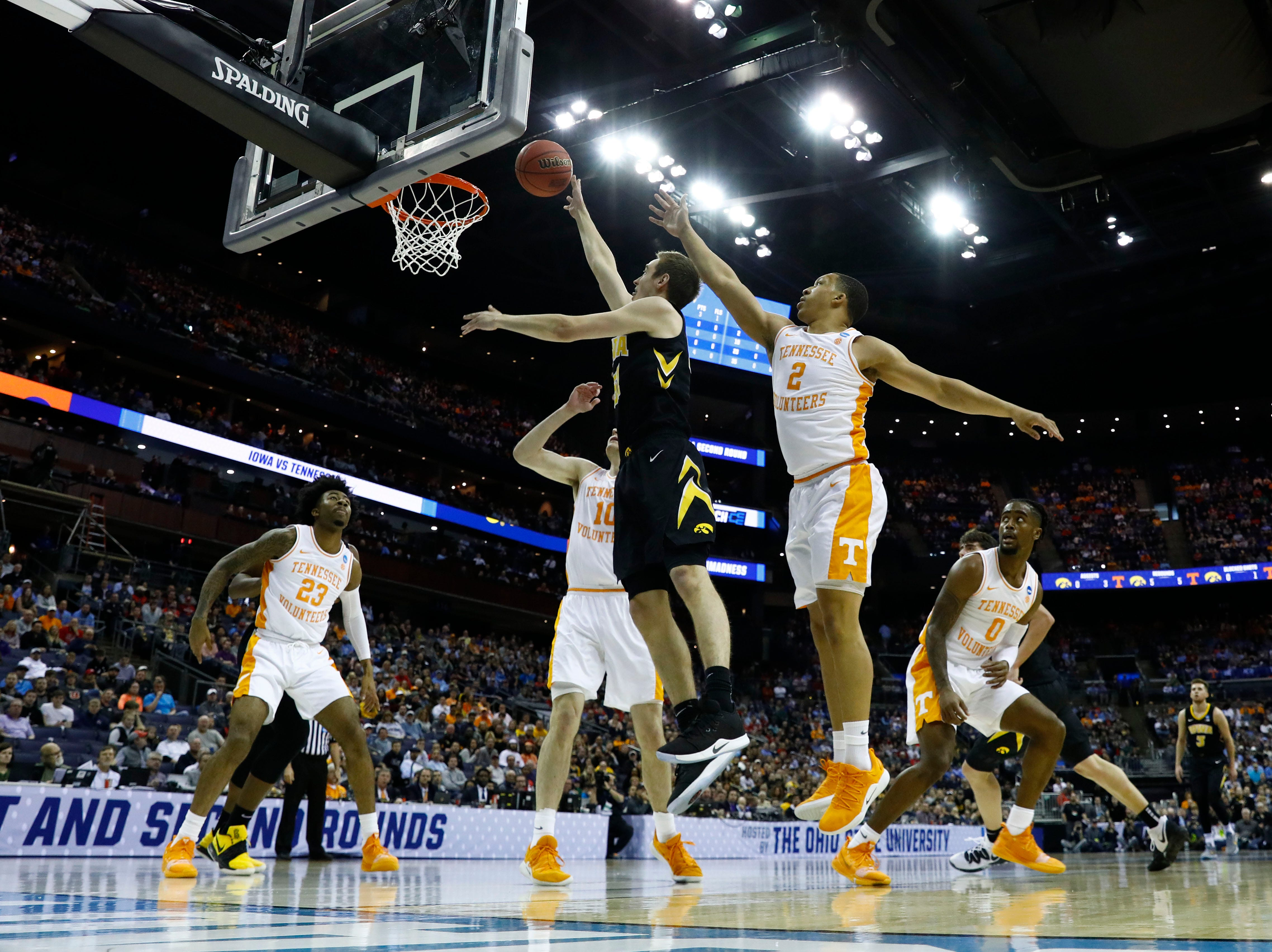 Iowa Hawkeyes forward Nicholas Baer (51) goes to the basket defended by Tennessee Volunteers guard Jordan Bone (0) in the first half in the second round of the 2019 NCAA Tournament at Nationwide Arena.