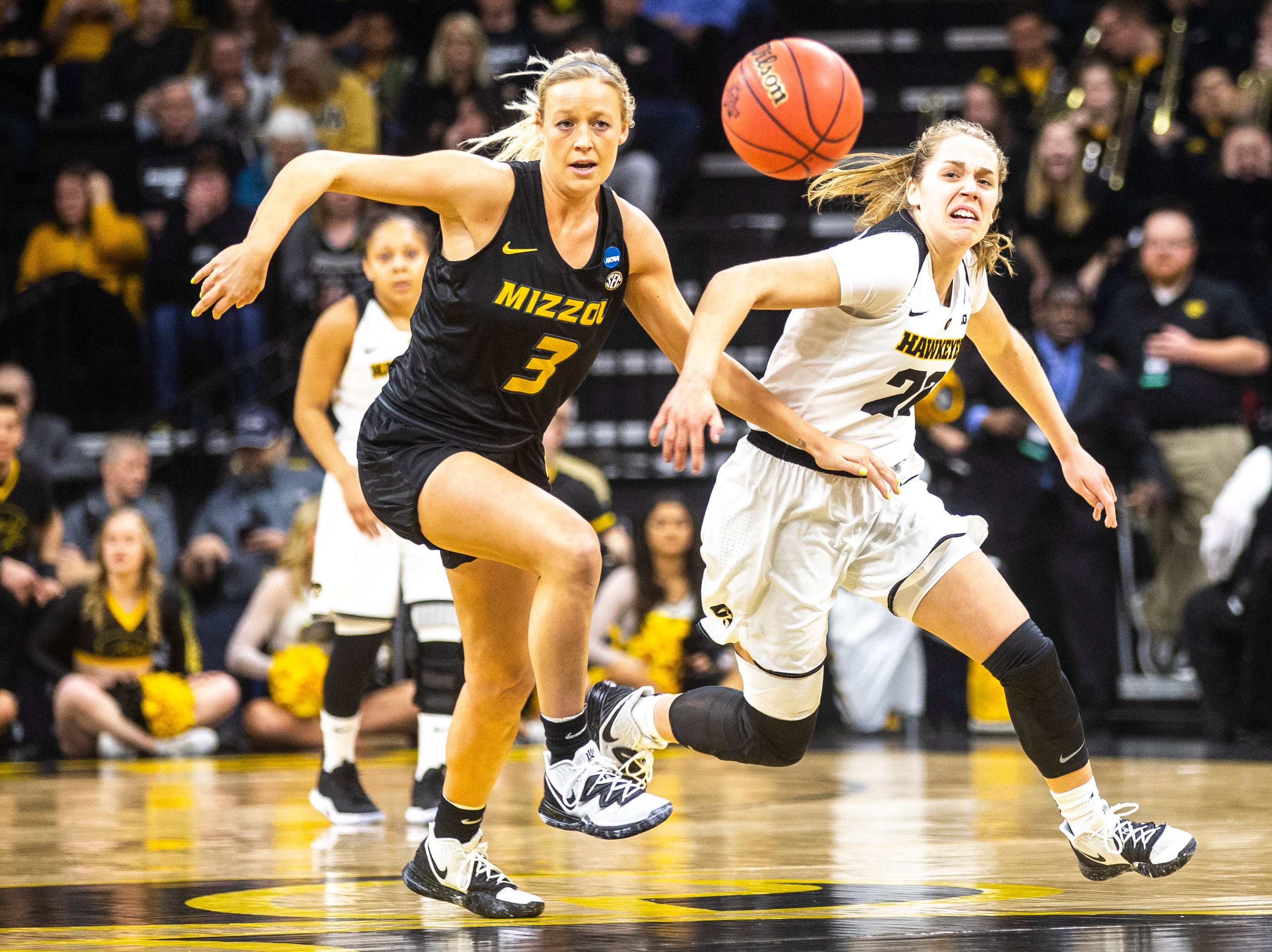 Missouri guard Sophie Cunningham (3) and Iowa guard Kathleen Doyle (22) chase down a loose ball during a NCAA women's basketball tournament second-round game, Sunday, March 24, 2019, at Carver-Hawkeye Arena in Iowa City, Iowa.