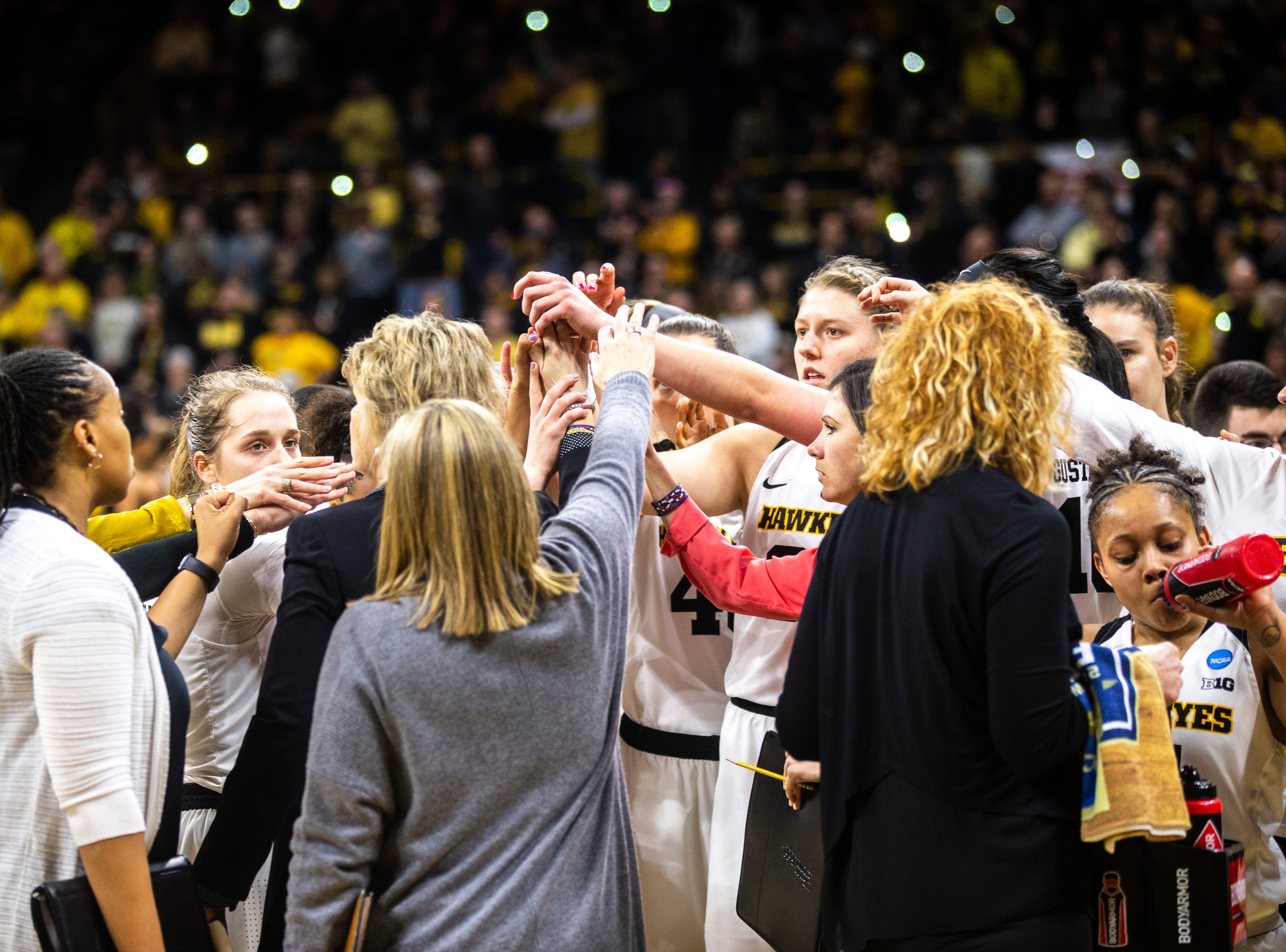Iowa head coach Lisa Bluder huddles with players in a timeout during a NCAA women's basketball tournament second-round game, Sunday, March 24, 2019, at Carver-Hawkeye Arena in Iowa City, Iowa.