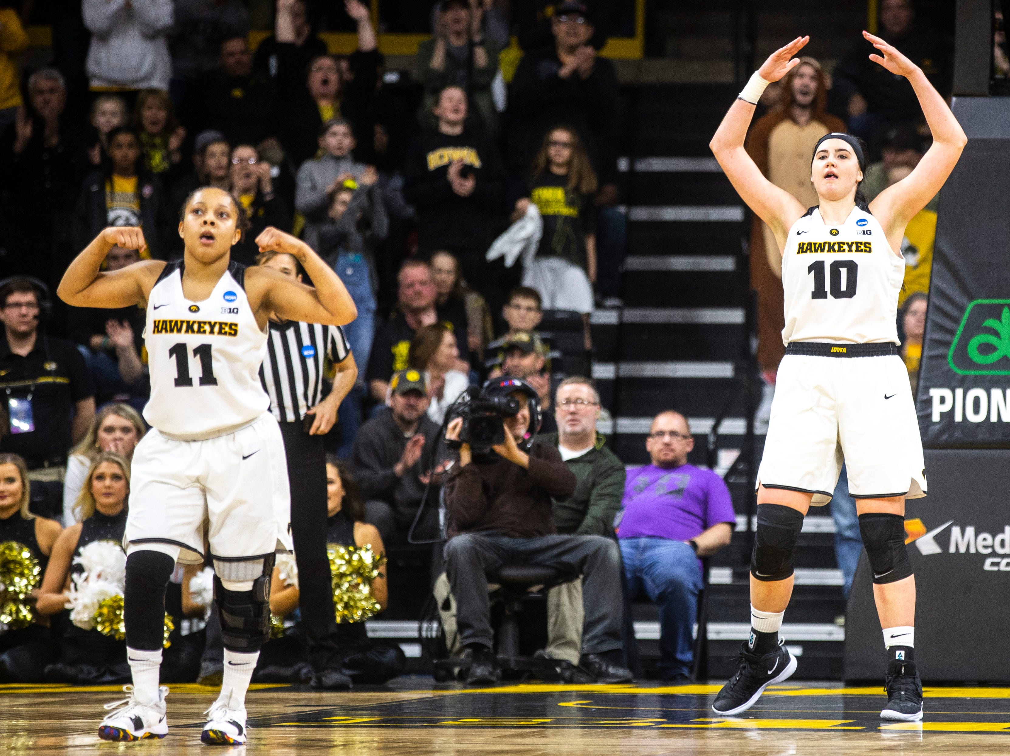 Iowa center Megan Gustafson (10) pumps up the crowd with Iowa guard Tania Davis (11) while they settle in on defense during a NCAA women's basketball tournament second-round game, Sunday, March 24, 2019, at Carver-Hawkeye Arena in Iowa City, Iowa.